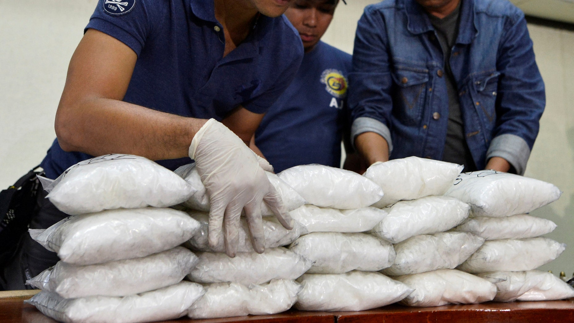 "File photo: Members of the Philippine National Police (PNP) get inventory of plastic bags containing methamphetamine hydrochloride known locally as ""shabu"", after they were seized in a police anti-drugs operation, at a police station in Manila, Philippines November 4, 2016. (REUTERS/Ezra Acayan)"