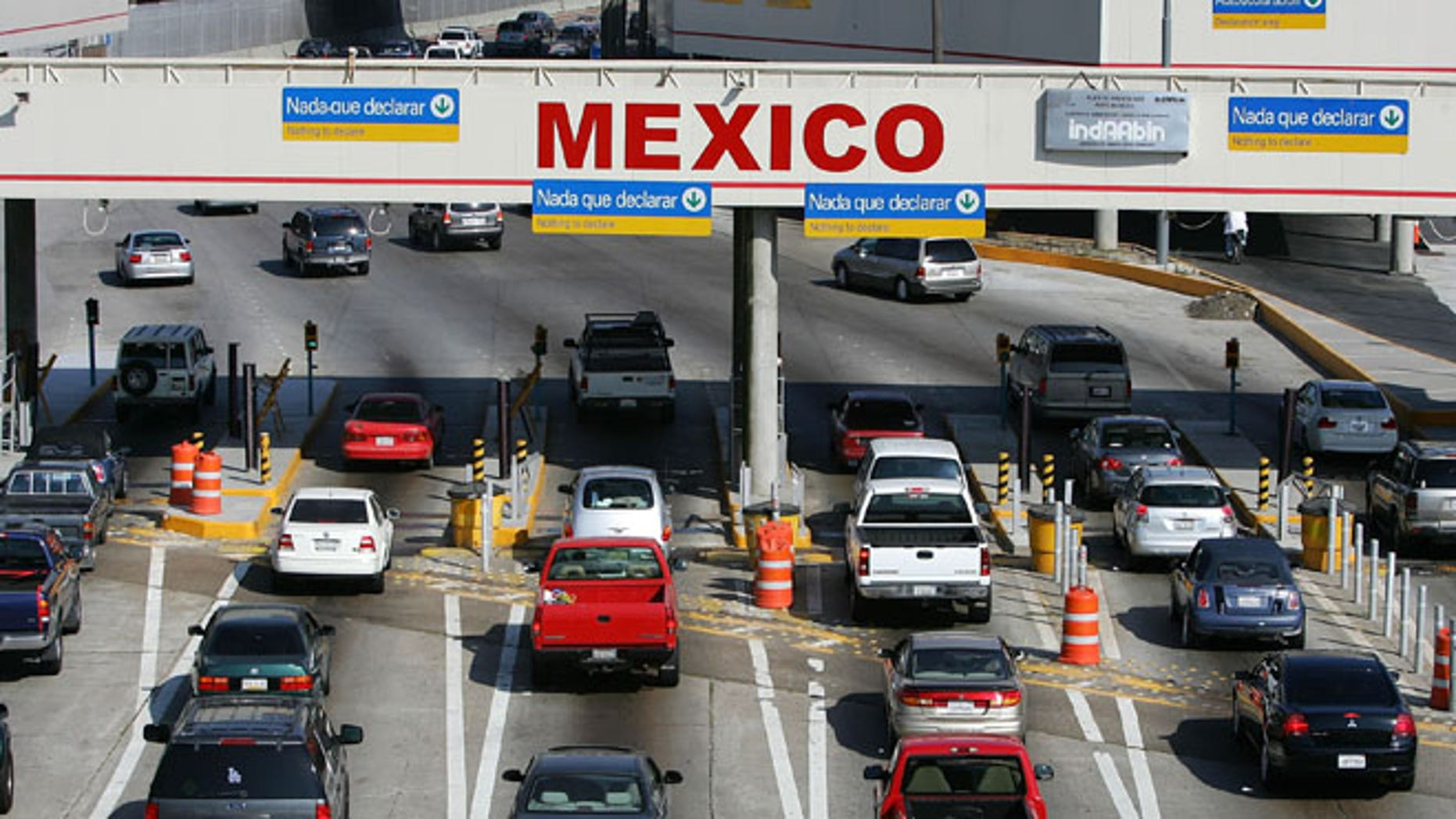TIJUANA, MEXICO - JUNE 27:  Traffic in the US enters Mexico at the San Ysidro border crossing, the world?s busiest, on June 27, 2008 in Tijuana, Mexico. With the cost of gasoline in California around $4.60 per gallon, many drivers are buying their fuel in Mexico for about $3.20. There is a price to pay for cheaper gas though. Mexican gas is formulated with more sulfur than California gas and that can damage the emission control equipment on US cars, causing them to fail emissions tests and leading to expensive repairs. In addition, unless a driver has other business in Mexico, part of their fuel savings will be burned up idling in a line that can easily last for hours to get back into the US.   (Photo by David McNew/Getty Images)