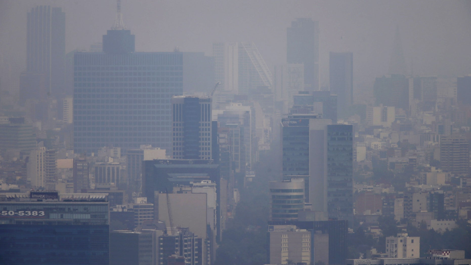 March 16, 2016: Buildings stand shrouded in smog in Mexico City.