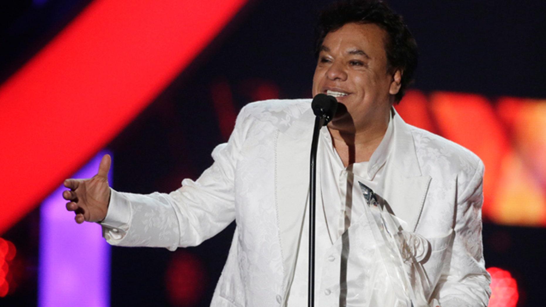 In this April 28, 2016, file photo, singer Juan Gabriel receives the Star Award at the Latin Billboard Awards, in Coral Gables, Fla.