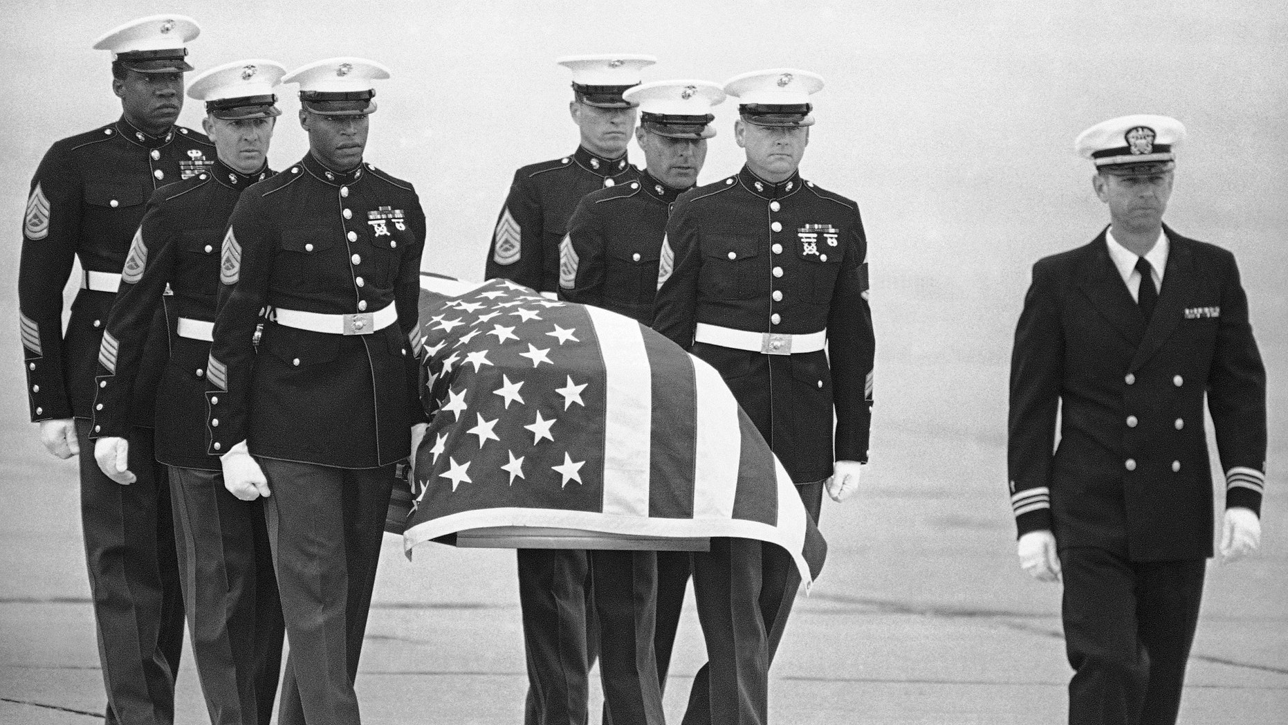 FILE - In this March 8, 1985, file photo, U.S. Marine Corps pallbearers carry the casket holding the body of slain U.S. Drug Enforcement agent Enrique Camarena Salazar after it arrived at North Island Naval Air Station, in San Diego.