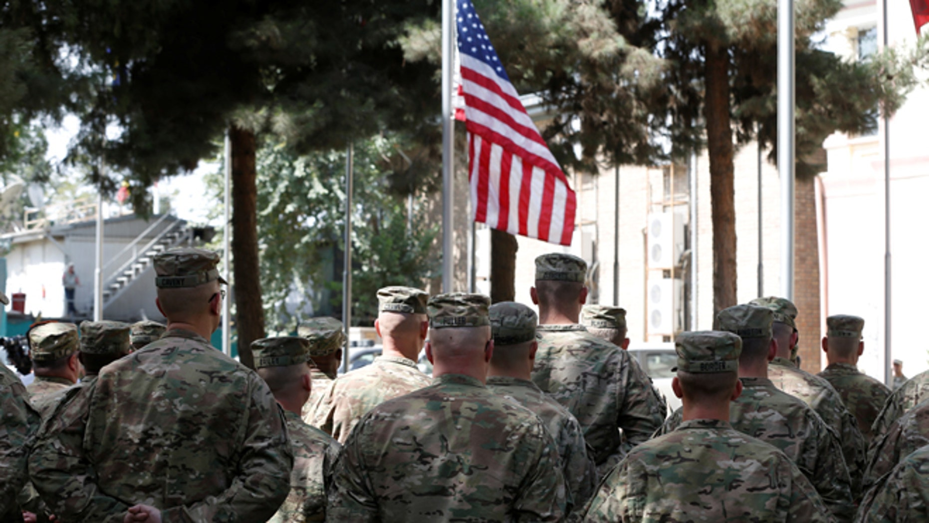 U.S. soldiers take part in a memorial ceremony to commemorate the 15th anniversary of the 9/11 attacks, in Kabul, Afghanistan September 11, 2016. REUTERS/Omar Sobhani  - RTSN7ED