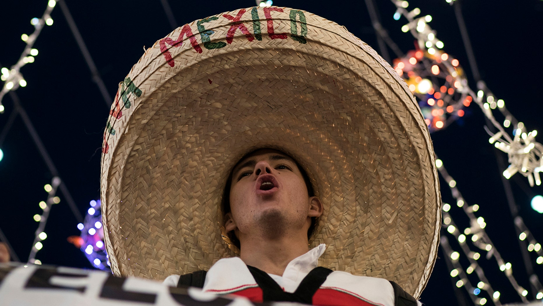 A Mexico soccer fan wearing a sombrero chants as fans gather on Nikolskaya Street, in Moscow, June 13, 2018.
