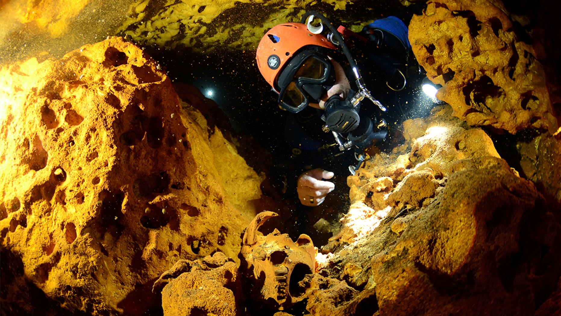 A scuba diver looks at an animal skull at Sac Aktun underwater cave system during exploration as part of the Gran Acuifero Maya Project near Tulum, in Quintana Roo state, Mexico February 12, 2014. (Jan Arild Aaserud/Courtesy Gran Acuifero Maya Project [GAM]/Handout via REUTERS)