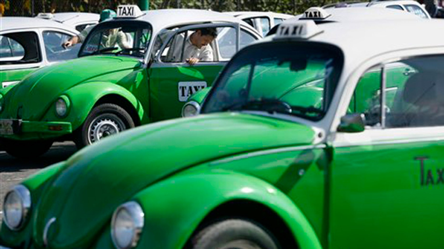 Dec. 28, 2007: In this photo, a man steps out of his Volkswagen beetle taxi during an inspection in Mexico City.  Mexico City has announced that the last of the iconic Volkswagen Beetle taxis will be withdrawn from service by the end of 2012.