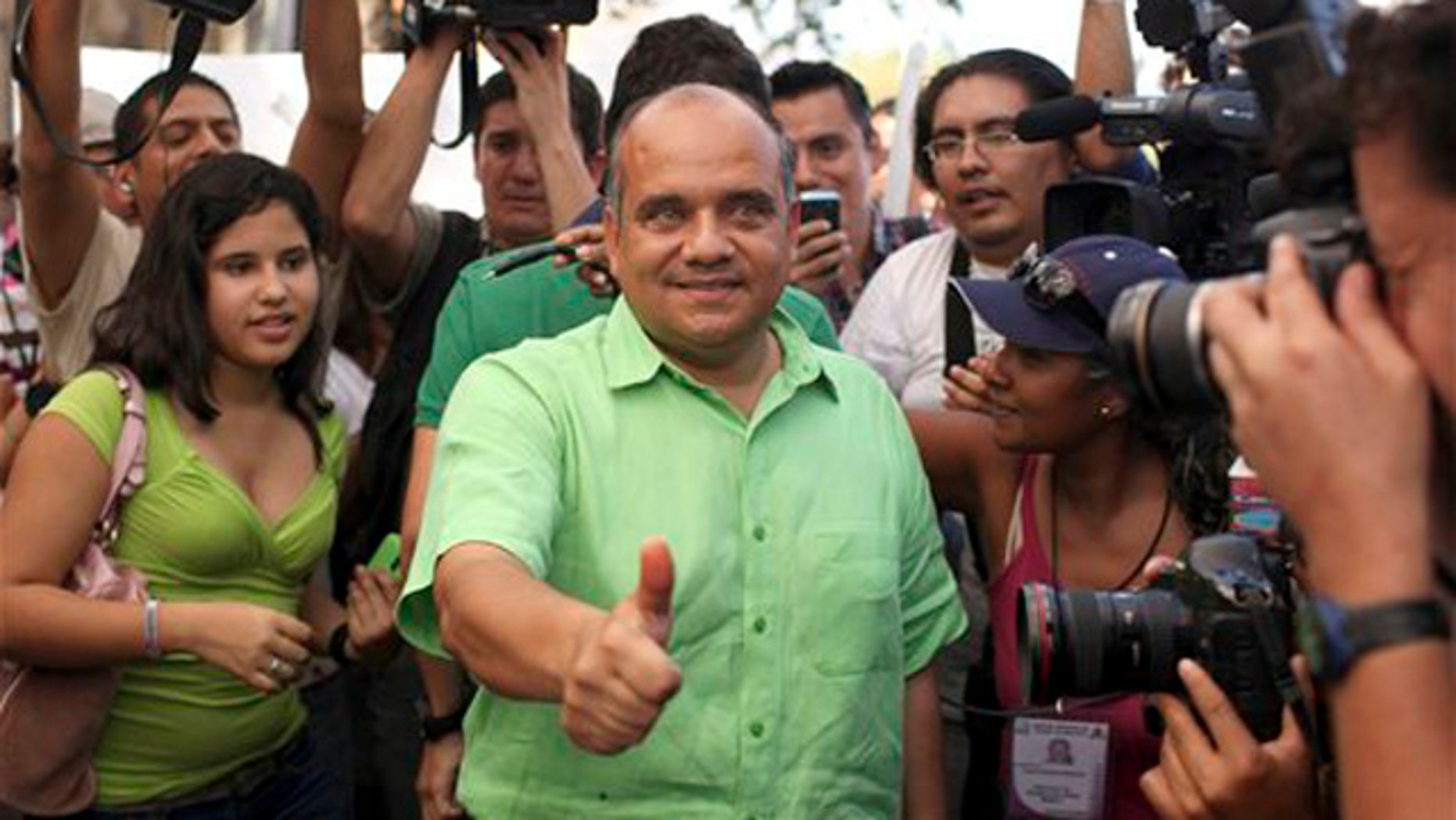 Jan. 30, 2011: Candidate for state governor Manuel Anorve, of the Institutional Revolutionary Party, PRI, center, gestures as he poses for photos after casting his vote in Acapulco, Mexico. Corruption scandals, political violence and the drug war shadow Sunday's gubernatorial election in the Pacific coast state of Guerrero, home to the resort city of Acapulco and a cartel battleground.