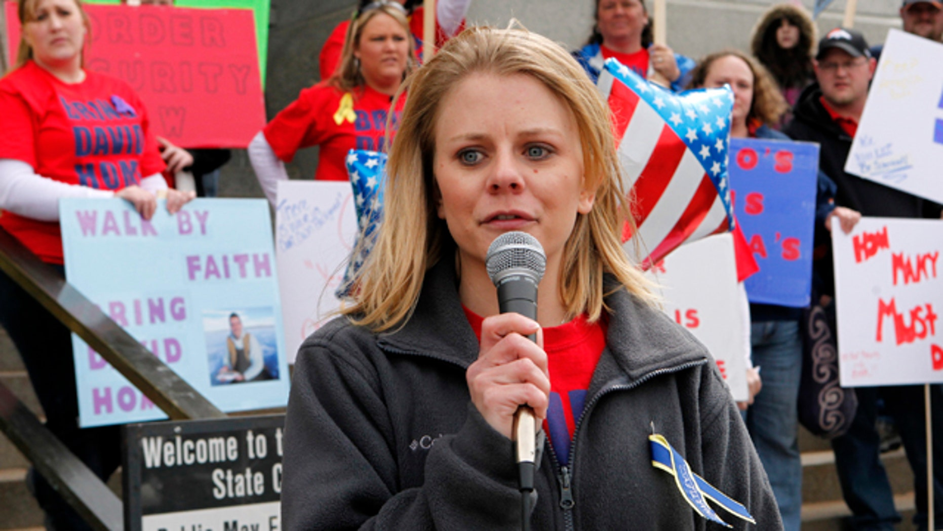 March 30, 2011: Tiffany Hartley speaks at a rally at the Capitol in Denver, where she demanded that the U.S. government do more to find the body of her husband, David Hartley, who was presumably gunned down on a lake along Texas' border with Mexico.
