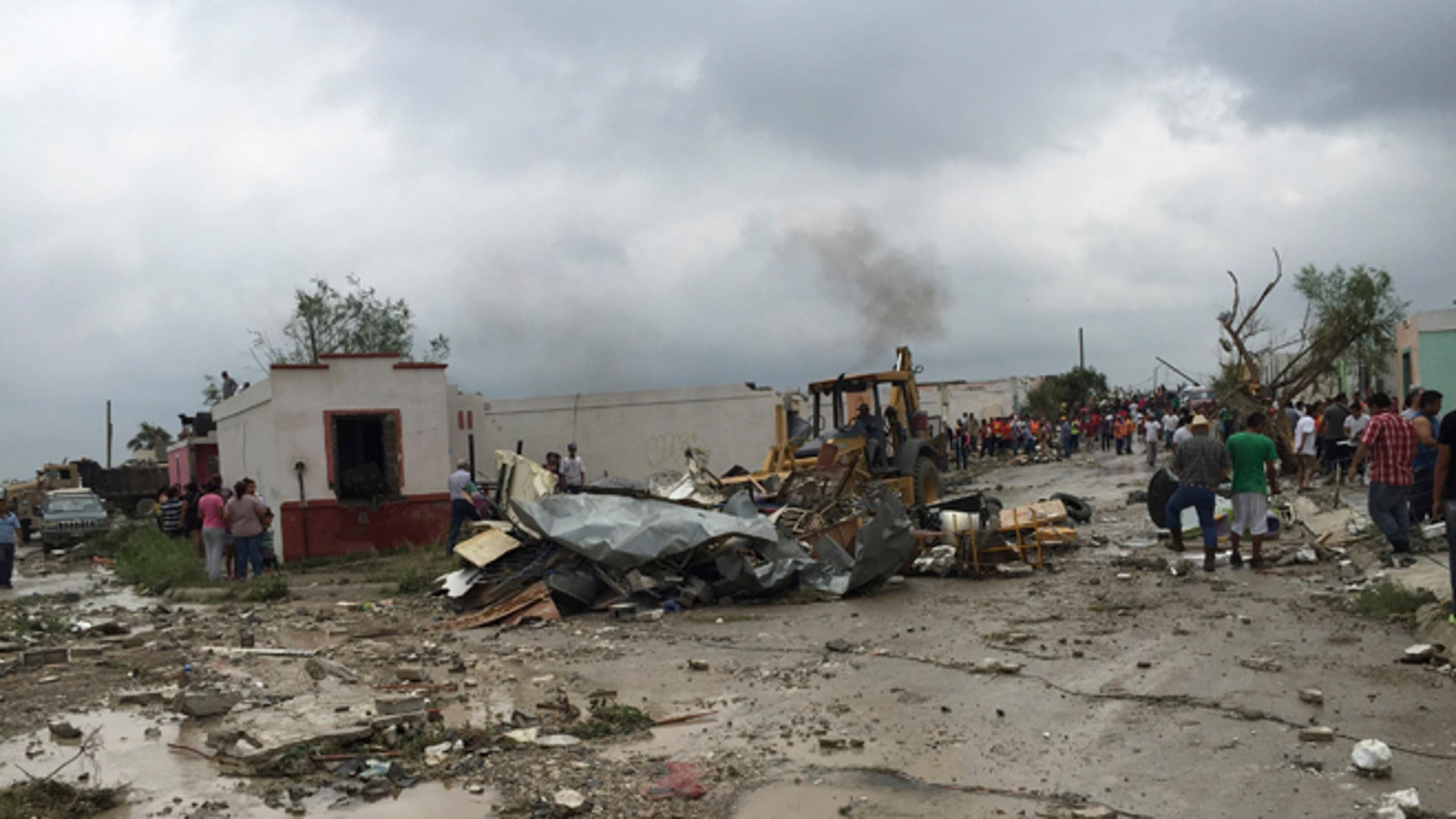 May 25, 2015: A bulldozer clears away debris after a powerful tornado swept past in Ciudad Acuna, northern Mexico.
