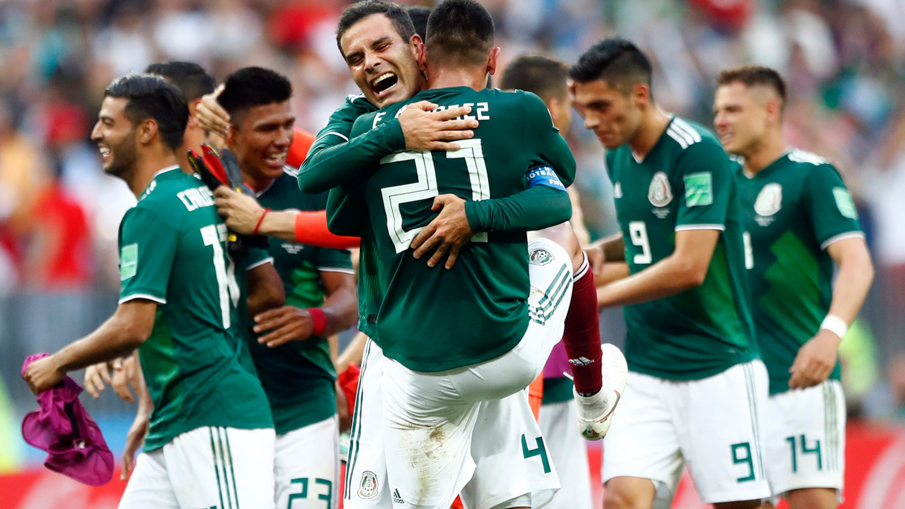 Mexico players celebrate after winning the group F match between Germany and Mexico at the 2018 soccer World Cup in the Luzhniki Stadium in Moscow, Russia, Sunday, June 17, 2018. Mexico won 1-0.