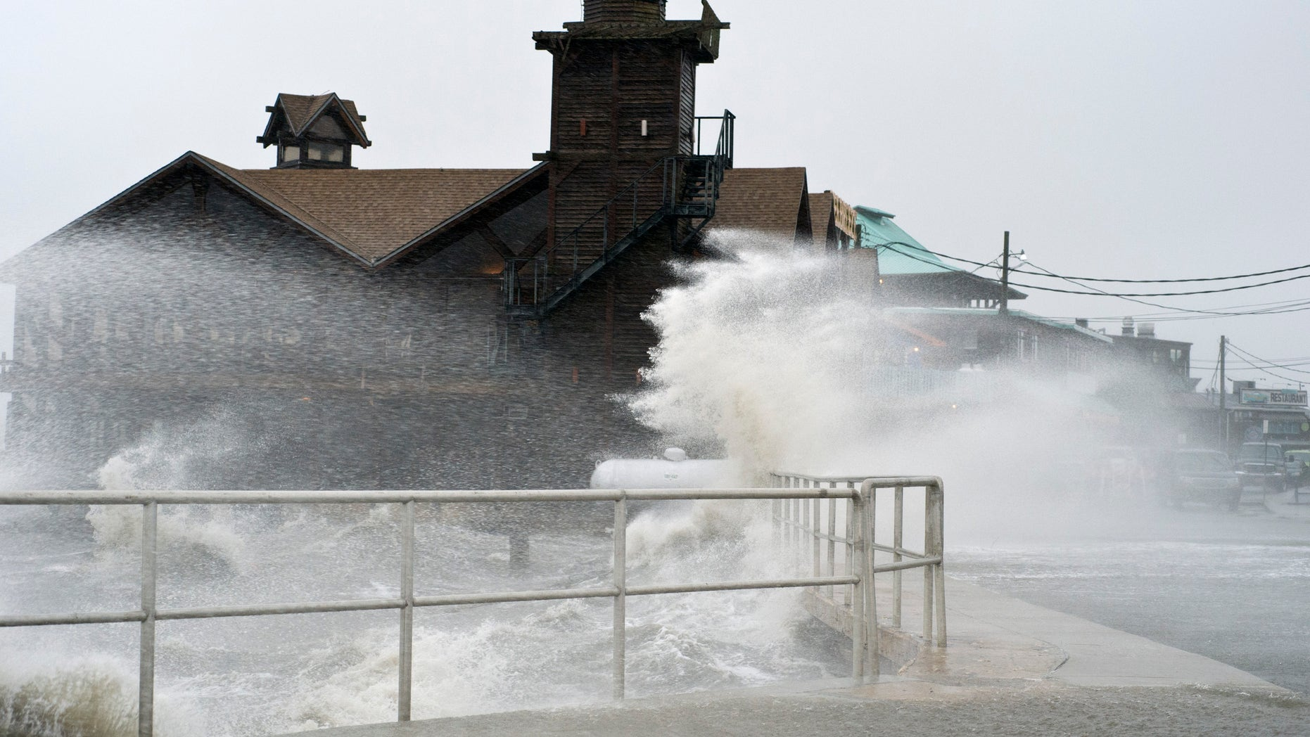 High winds, high tide strike at the main street of Cedar Key, Fla., as Tropical Storm Debby makes it's way across the Gulf of Mexico