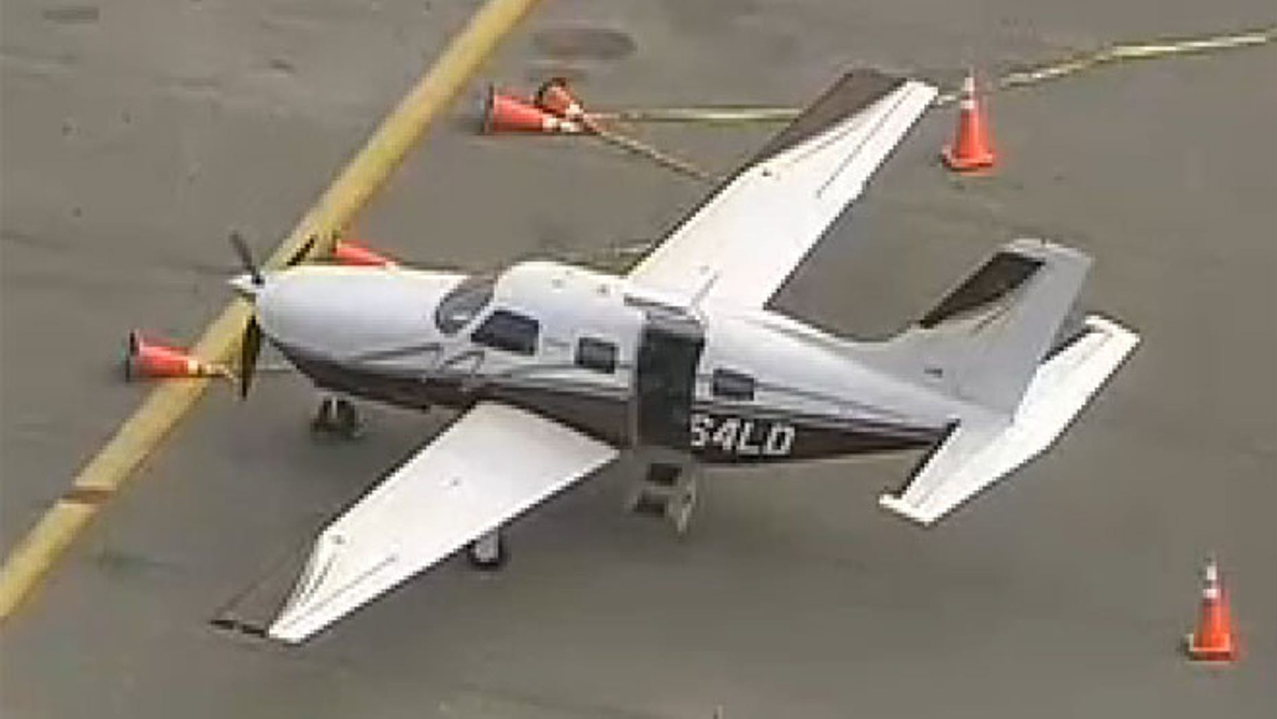 Nov. 14, 2013: A passenger fell out of this Piper PA 46 aircraft, which is shown at the Kendall-Tamiami Executive Airport in Miami.