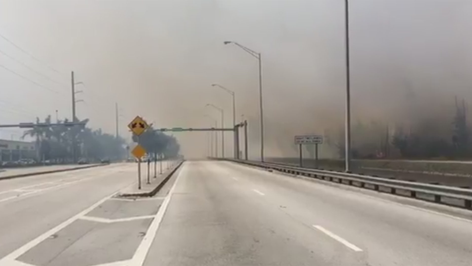 Haze from a fire Sunday in Miami-Dade County, Florida.