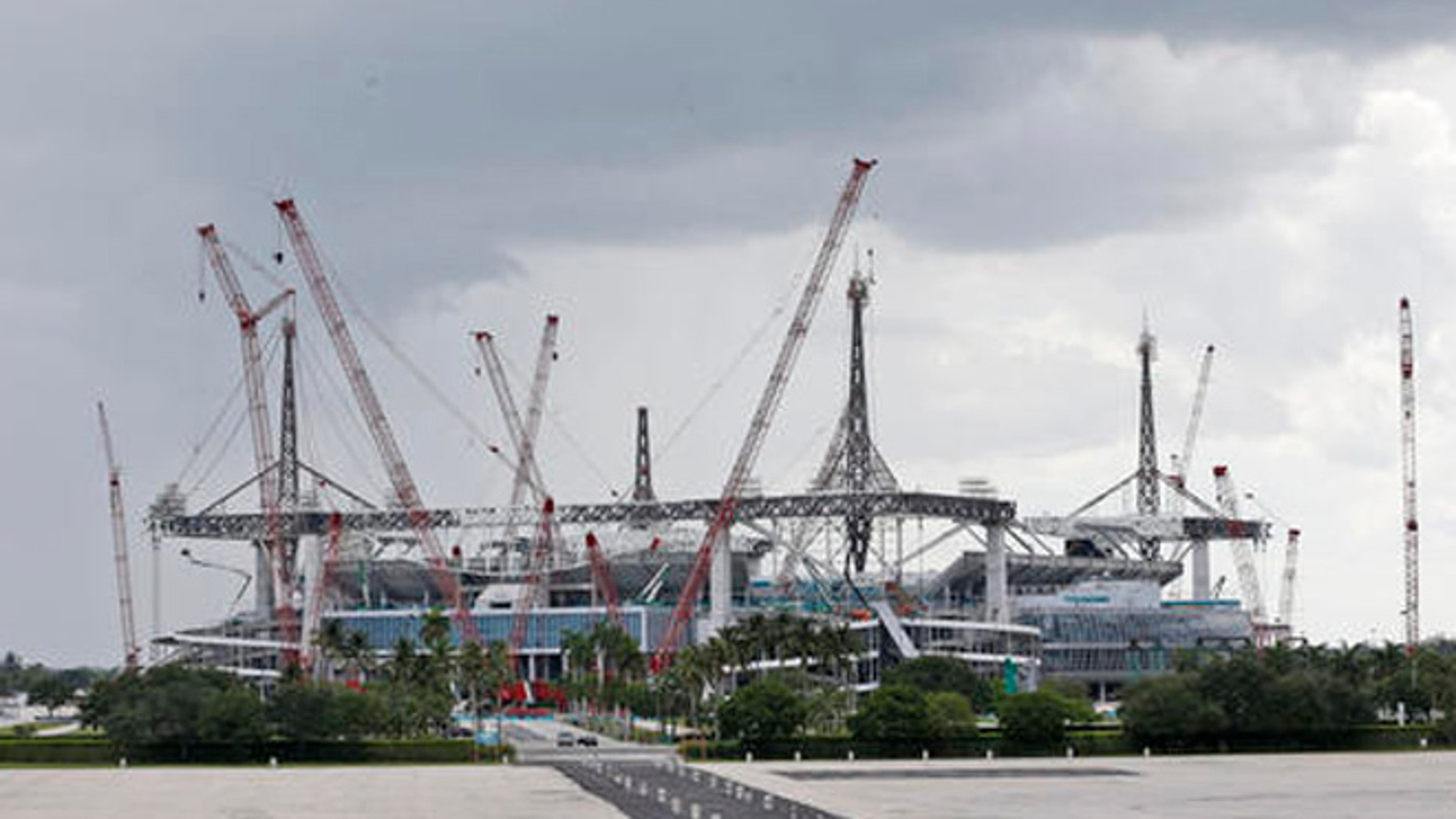 In this, Saturday, May 21, 2016, photo, the stadium where the Miami Dolphins play football is shown under renovation in Miami Gardens, Fla.