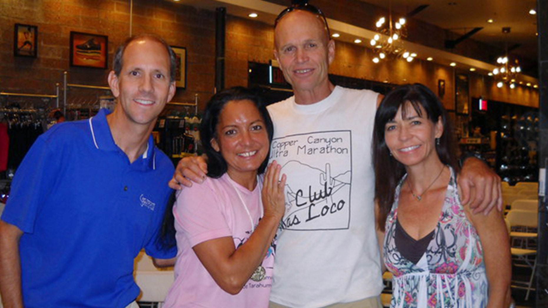 FILE June 2010: Micah True, center in the white shirt, had cardiomyopathy, a disease that results in the heart becoming enlarged.