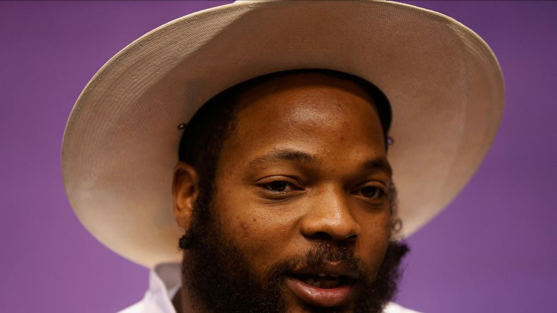 PHOENIX, AZ - JANUARY 27: Michael Bennett #72 of the Seattle Seahawks addresses the media at Super Bowl XLIX Media Day Fueled by Gatorade inside U.S. Airways Center on January 27, 2015 in Phoenix, Arizona. (Photo by Christian Petersen/Getty Images)