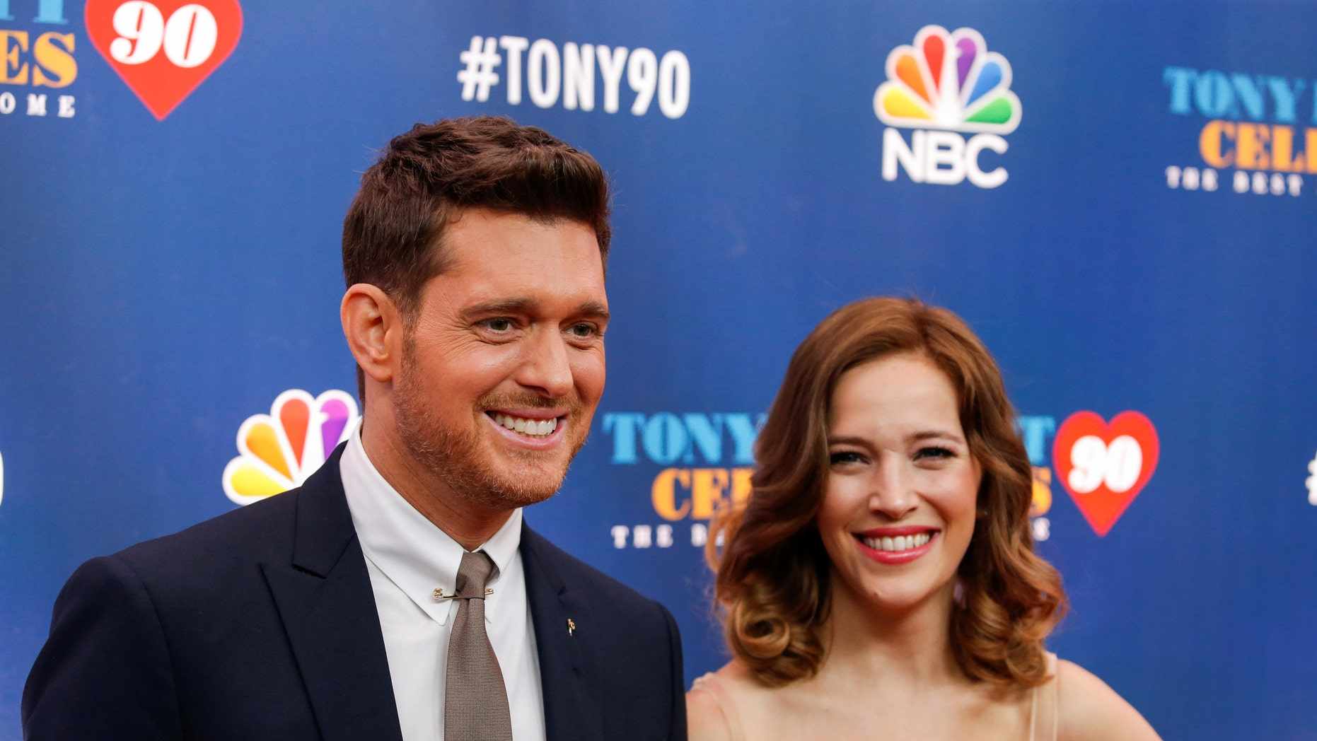 "Singer Michael Buble (L) and Luisana Lopilato walk on the red carpet for ""Tony Bennett Celebrates 90: The Best Is Yet to Come"" at the legendary Radio City Music Hall in New York, U.S., September 15, 2016."