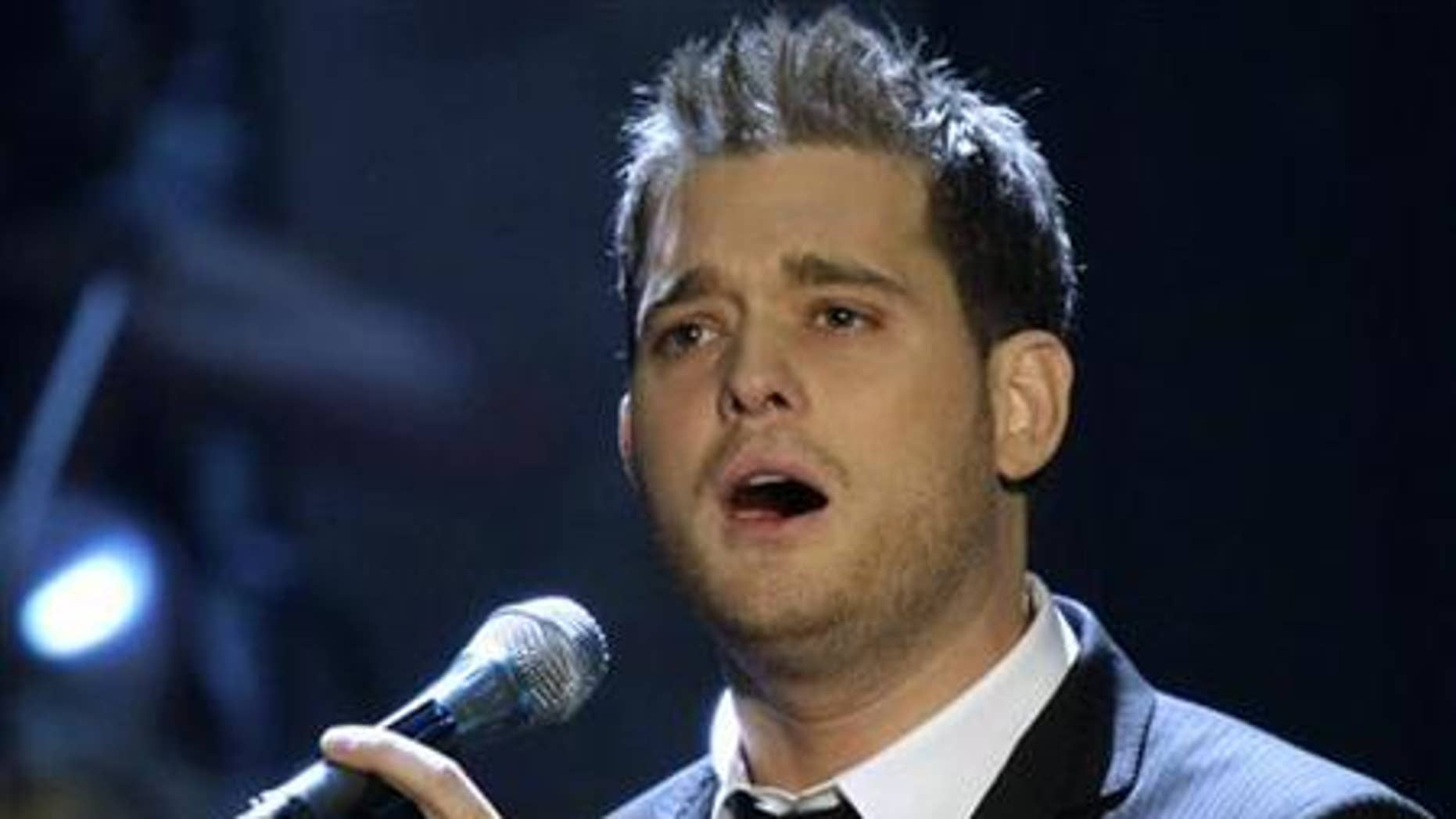 """Canadian singer and songwriter Michael Buble performs his song """"Lost"""" during the TV show """"Wetten, dass..?"""" (Bet it..?) in the eastern German city of Leipzig November 10, 2007. REUTERS/Eckehard Schulz/Pool"""
