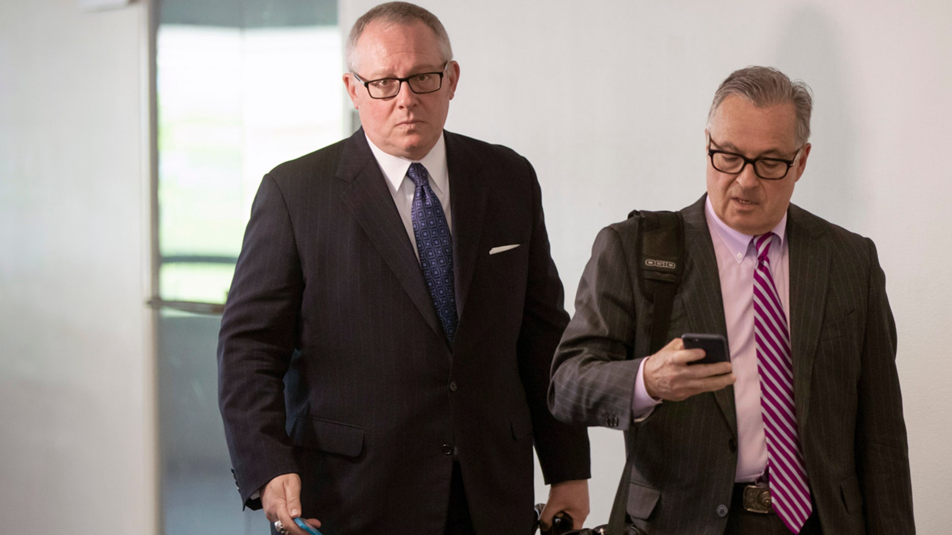 Michael Caputo, left, and attorney Dennis Vacco leave Caputo's interview with Senate Intelligence Committee staff on Capitol Hill in Washington Tuesday.