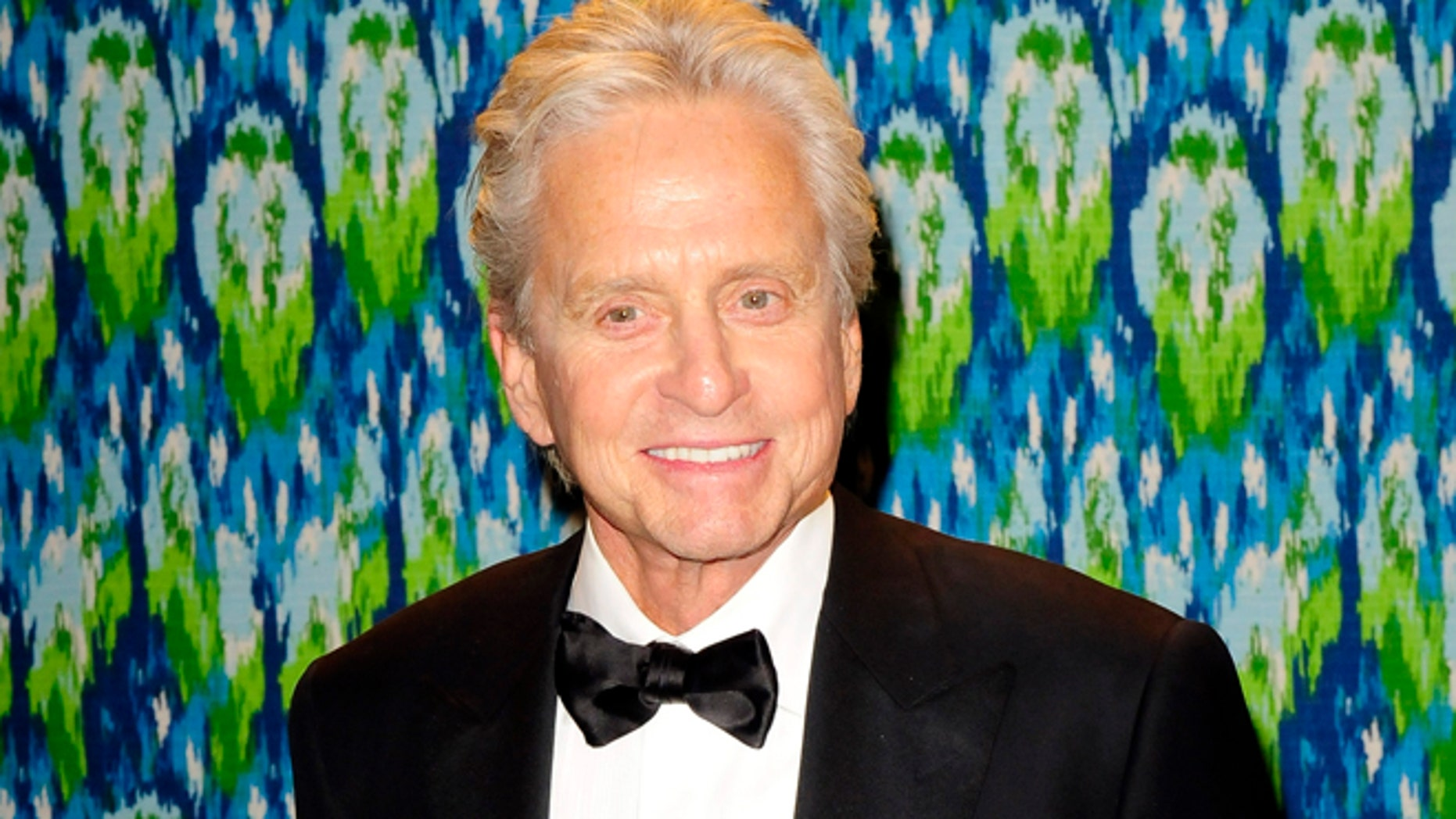 Winner of the Best Actor in a Mini-Series or TV Movie award Michael Douglas arrives at the 65th Primetime Emmy Awards HBO after-party in West Hollywood September 22, 2013. REUTERS/Gus Ruelas (UNITED STATES - Tags: ENTERTAINMENT) - RTX13WKH