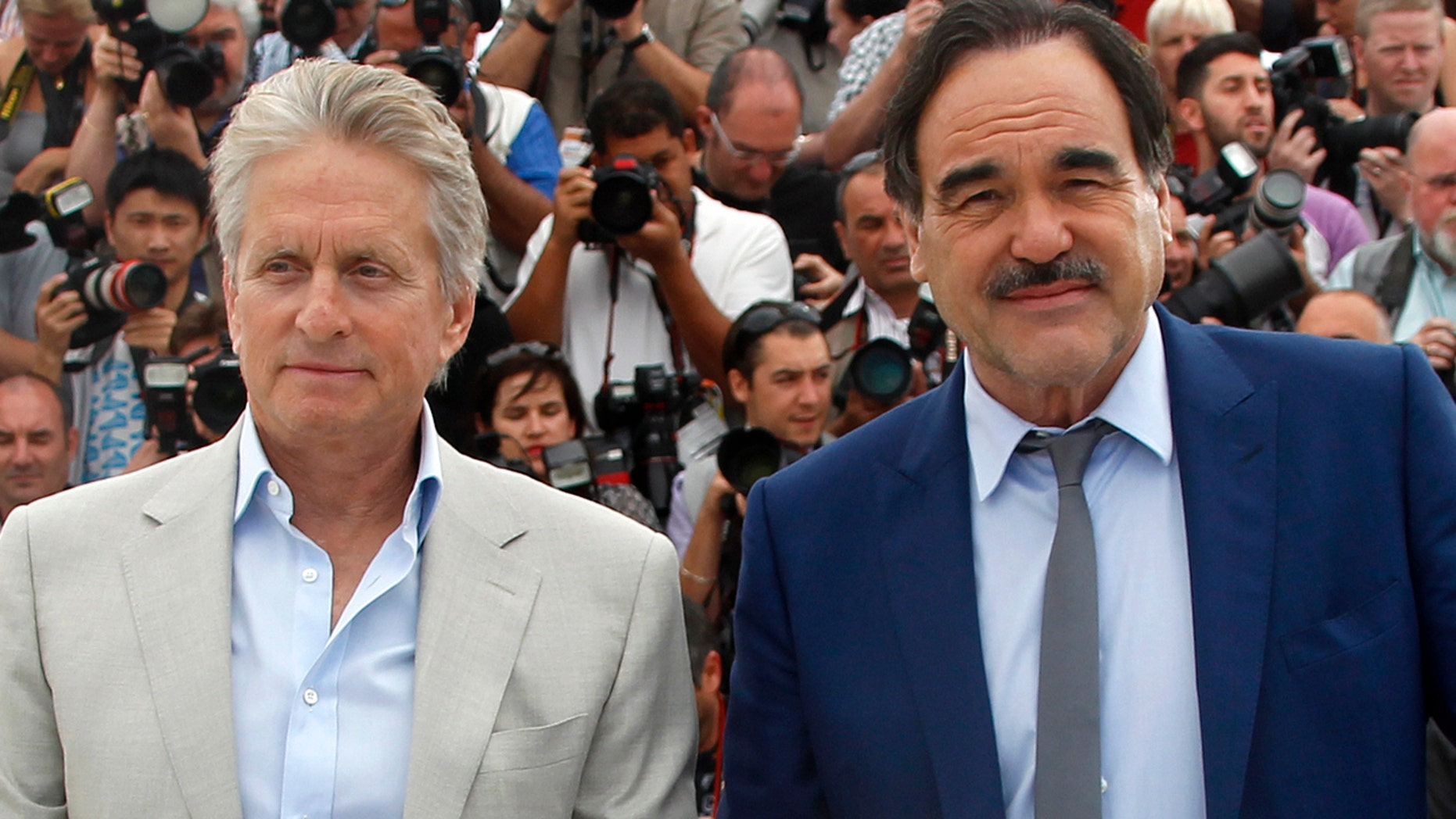 "Michael Douglas, left, poses with director Oliver Stone during a photocall for ""Wall Street - Money Never Sleeps."""
