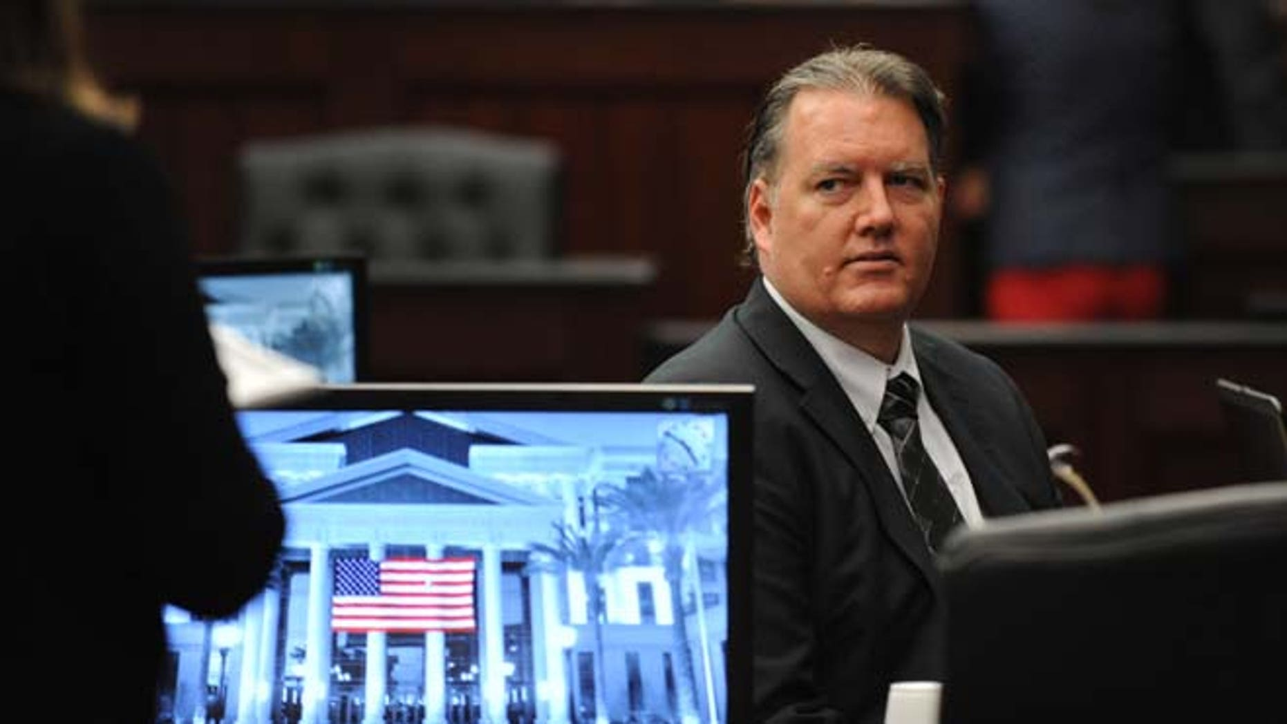 Sept. 27, 2014: Michael Dunn looks towards the legal representative sitting with his parents as his trial ends for the day in the Duval County Courthouse in Jacksonville, Fla.