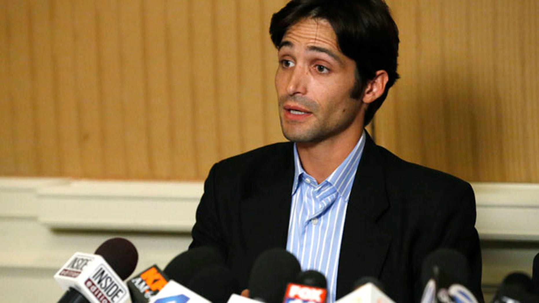 """Plaintiff Michael Egan speaks at a news conference at the Four Seasons Hotel in Los Angeles, California April 17, 2014. Egan filed a lawsuit on Wednesday against director Bryan Singer, accusing him of drugging and raping him in California and Hawaii in the late 1990s. Singer's attorney, Marty Singer, called the claims """"without merit"""" and """"absurd and defamatory.""""  REUTERS/Mario Anzuoni  (UNITED STATES - Tags: ENTERTAINMENT) - RTR3LQXU"""