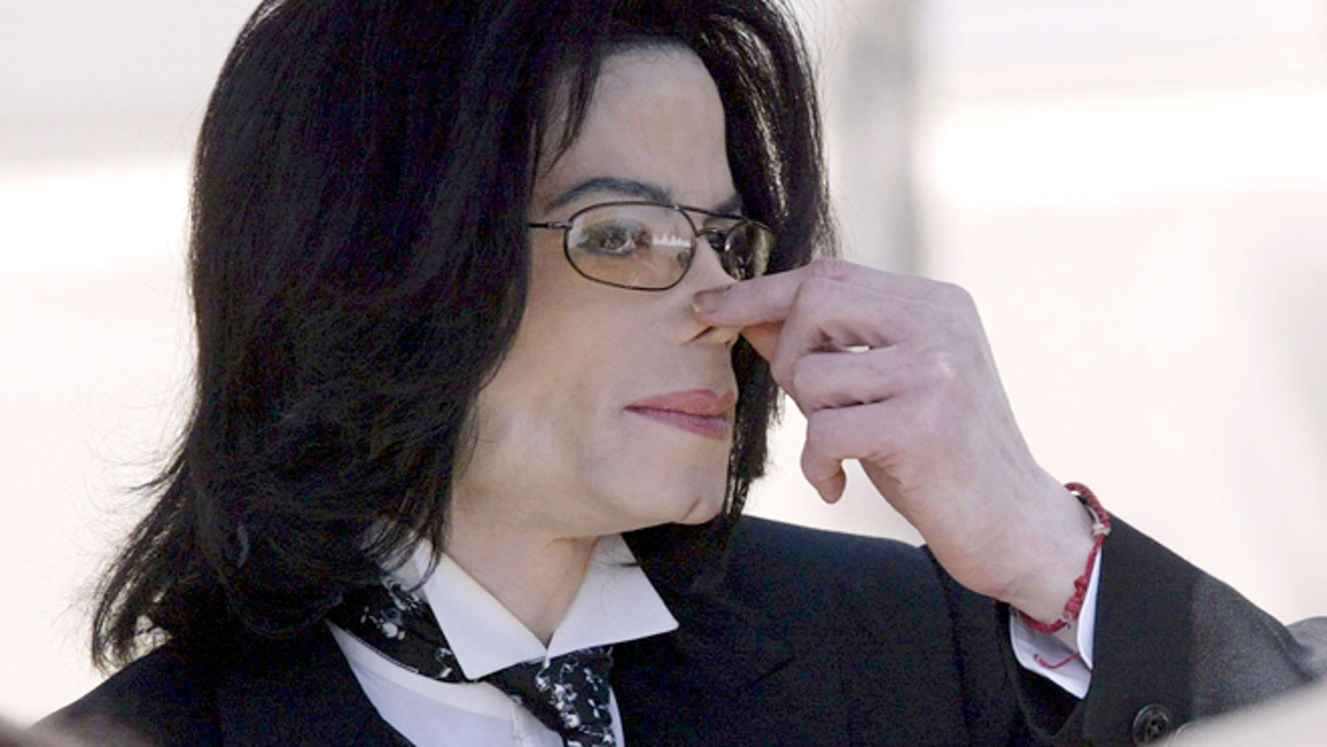 April 12, 2005: Michael Jackson touches his nose as he departs the Santa Barbara County courthouse in Santa Maria, Calif.