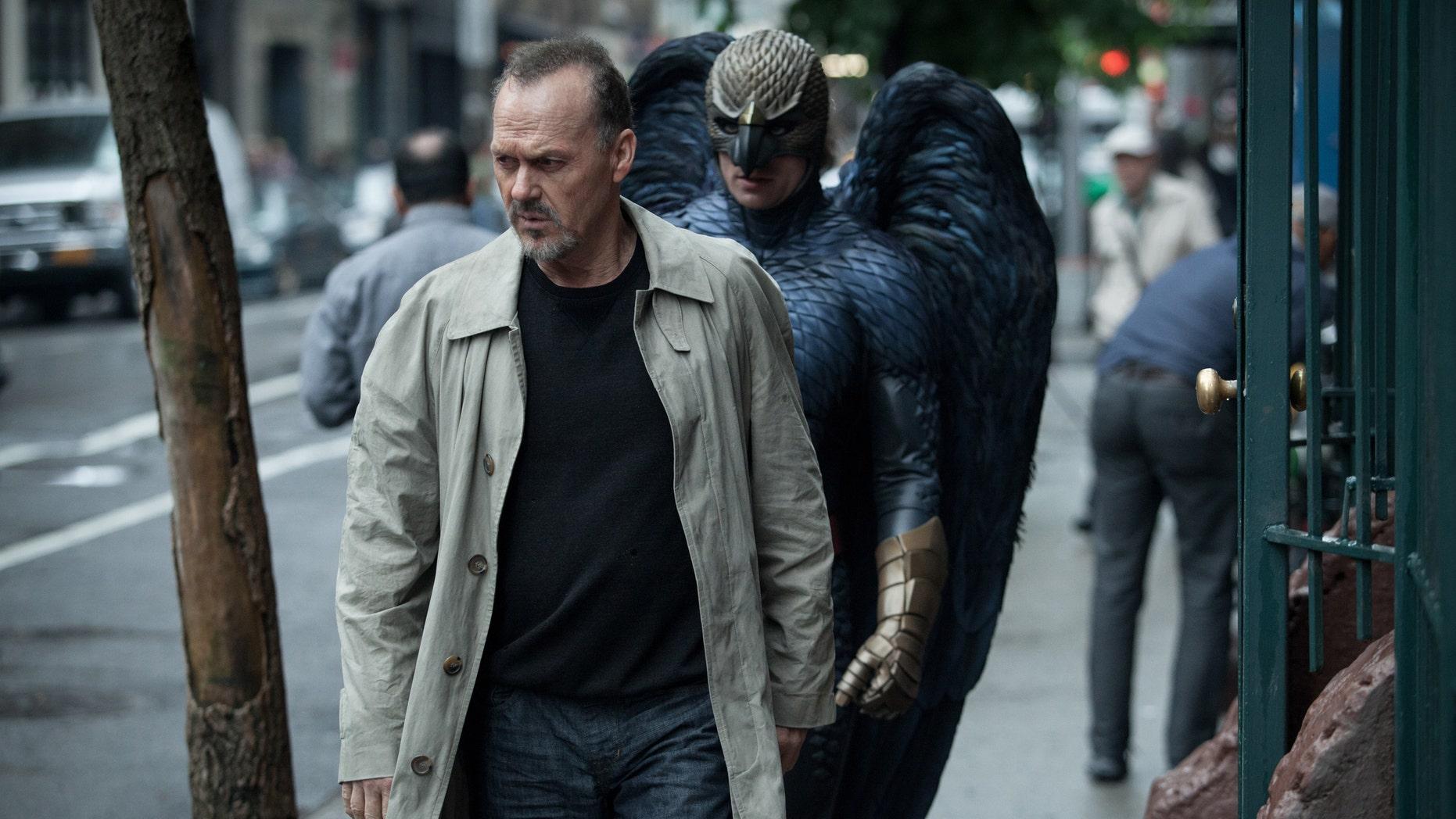 "Michael Keaton, left, as Riggan in a scene from the film, ""Birdman."""