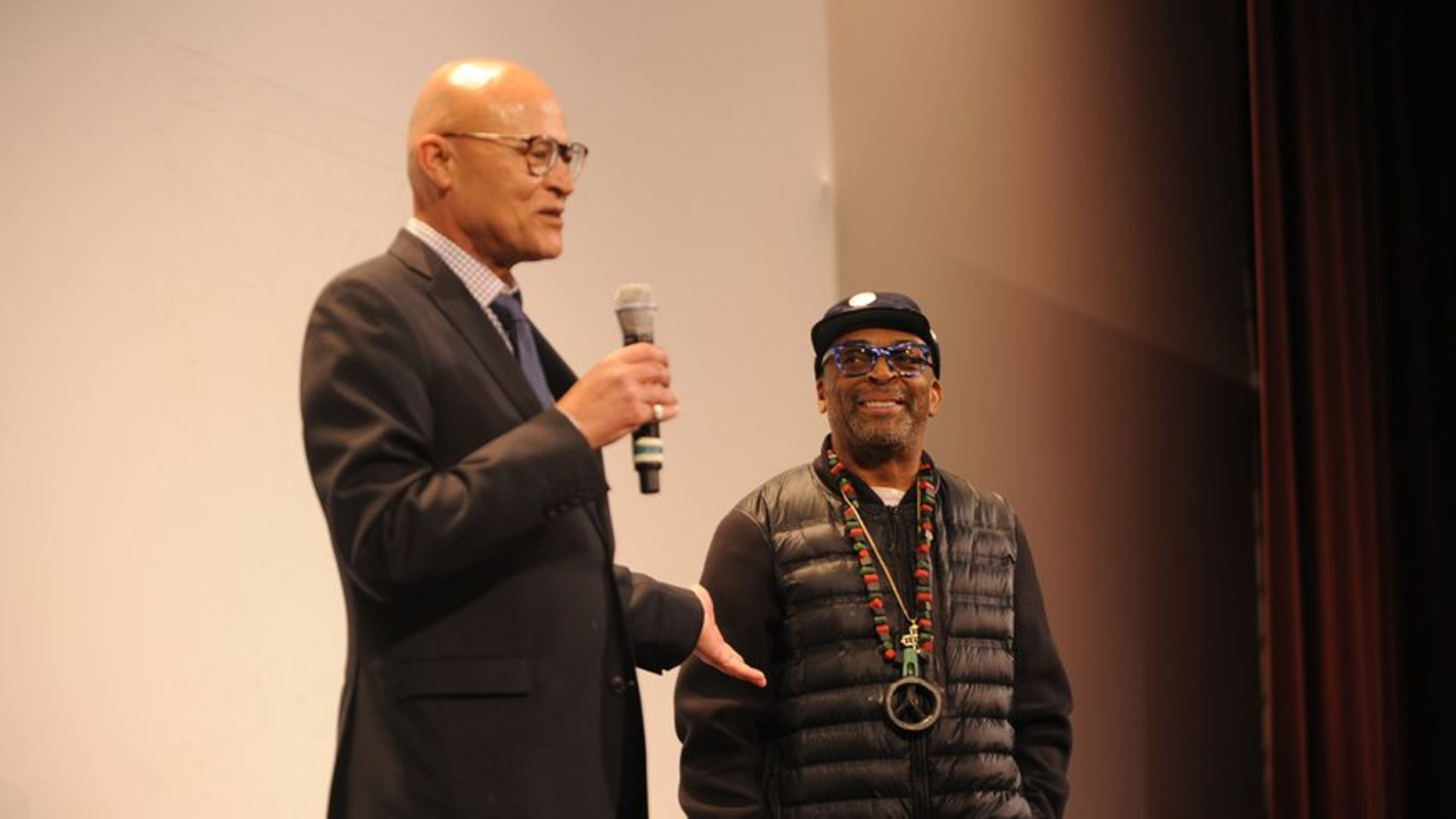Interim UM Systems President Mike Middleton, left, with filmmaker Spike Lee in April.