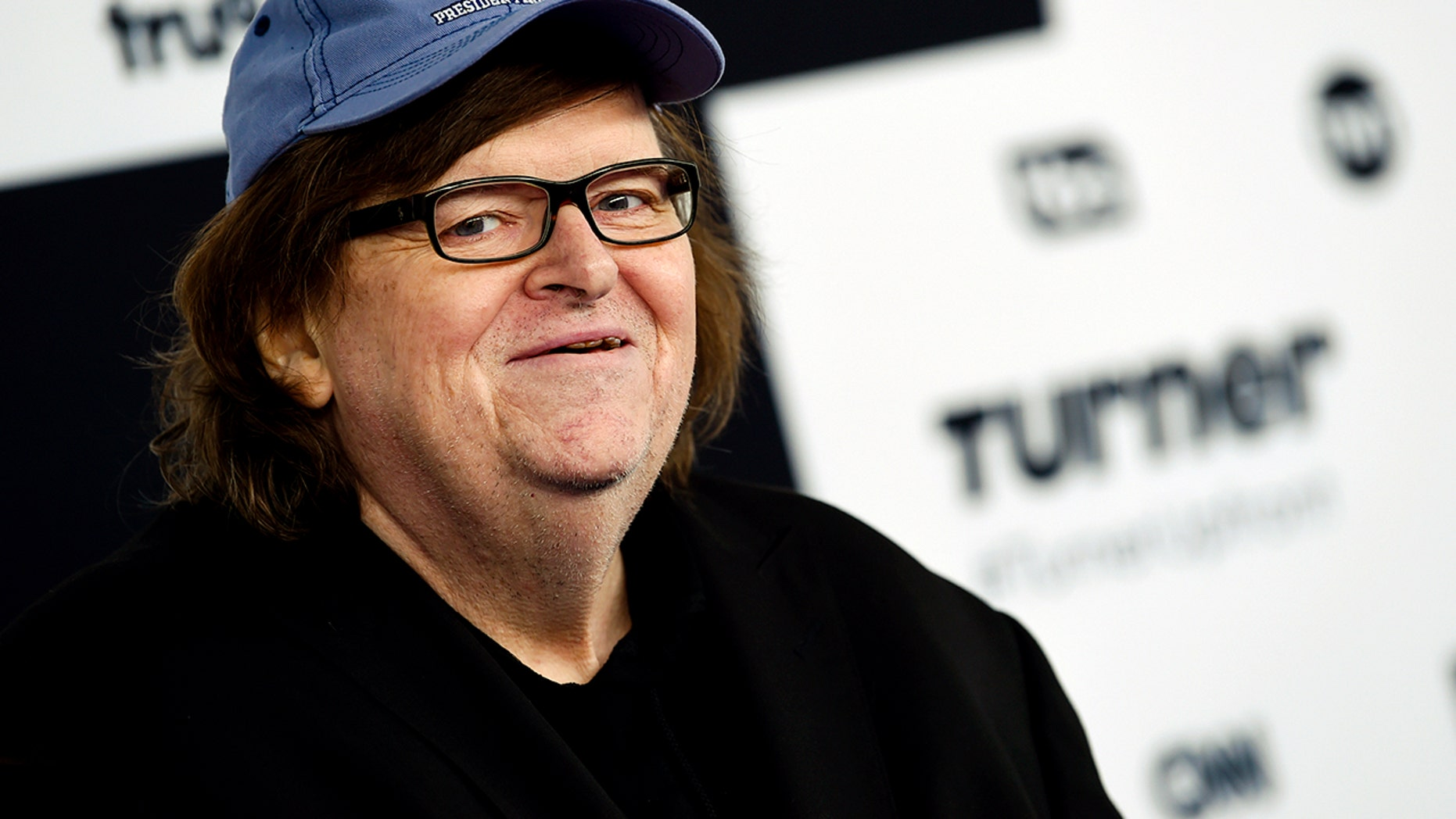 """Michael Moore expressed his frustration at the New York premiere for """"Flint,"""" a Lifetime movie about the water crisis. He says the problem with Flint's water supply could be fixed with new pipes but that hasn't been completed yet and he believes if the former auto town was in a more upscale area like Westchester, New York, the problem would be solved by now."""