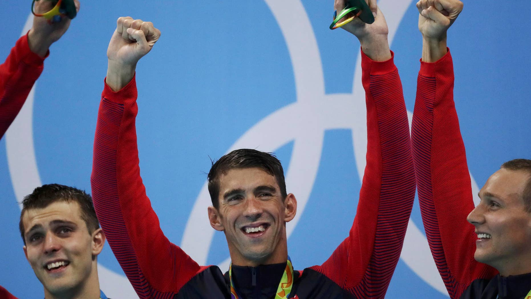 Michael Phelps, Ryan Held and Caeleb Dressel of USA celebrate on the podium during the 2016 Rio Olympics.