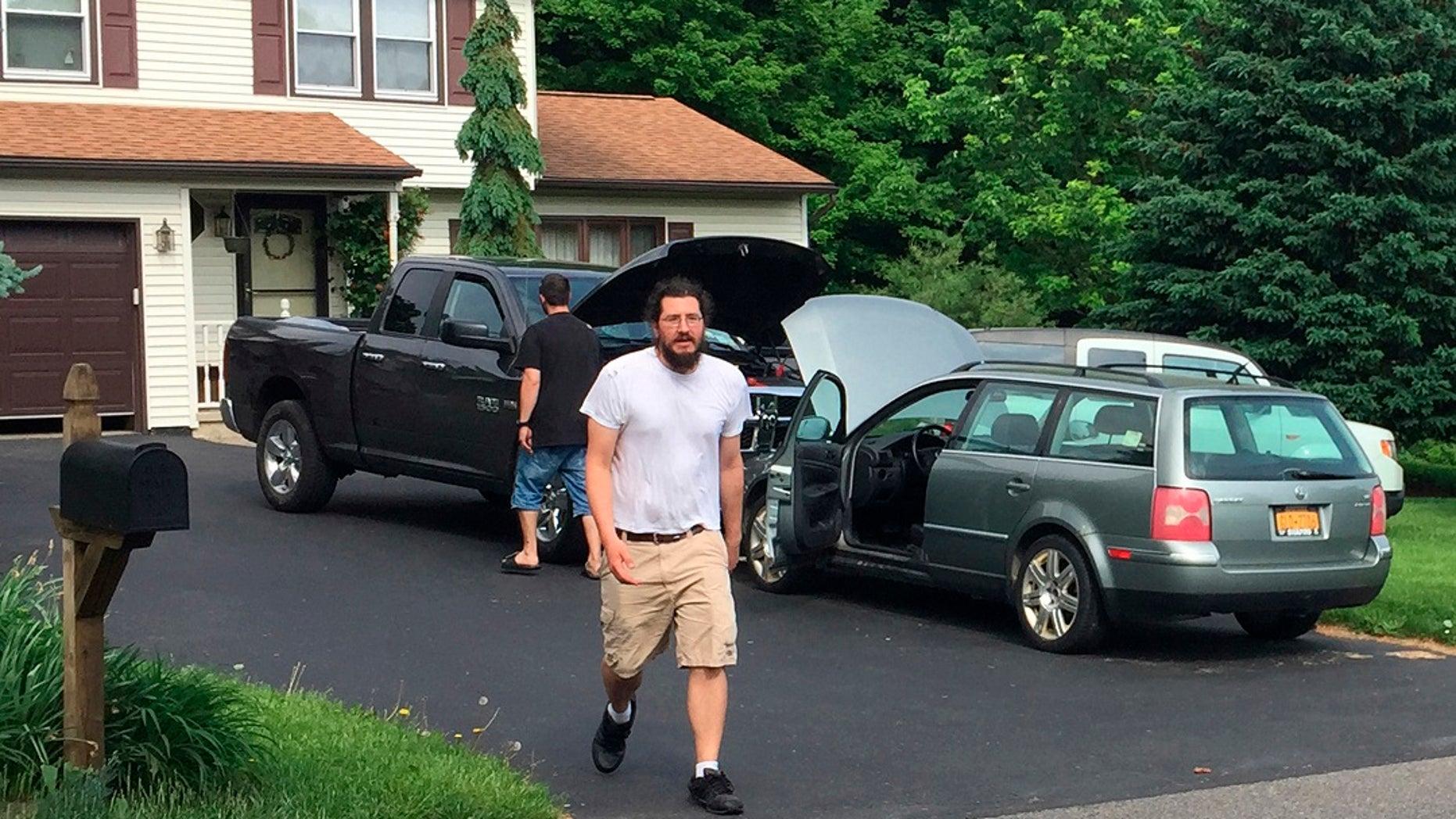 June 1, 2018: Michael Rotondo, 30, prepares to leave his parents' house in Camillus, N.Y.