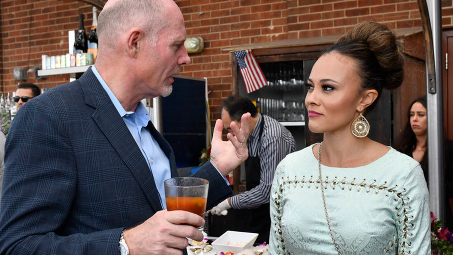 "Michael Darby, left, and wife Ashley Boalch Darby on an episode of ""The Real Housewives of Potomac."""