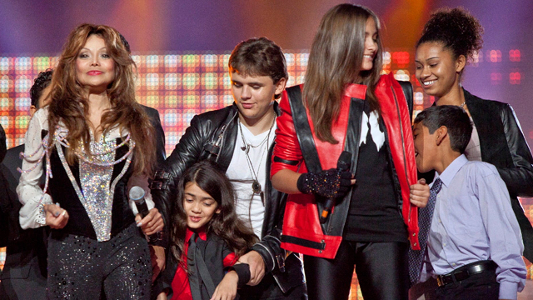Oct. 8: From left, Latoya Jackson, Blanket Jackson, Prince Jackson, Paris Jackson and others join together on stage for the finale of the Michael Forever the Tribute Concert, at the Millennium Stadium in Cardiff, Wales.