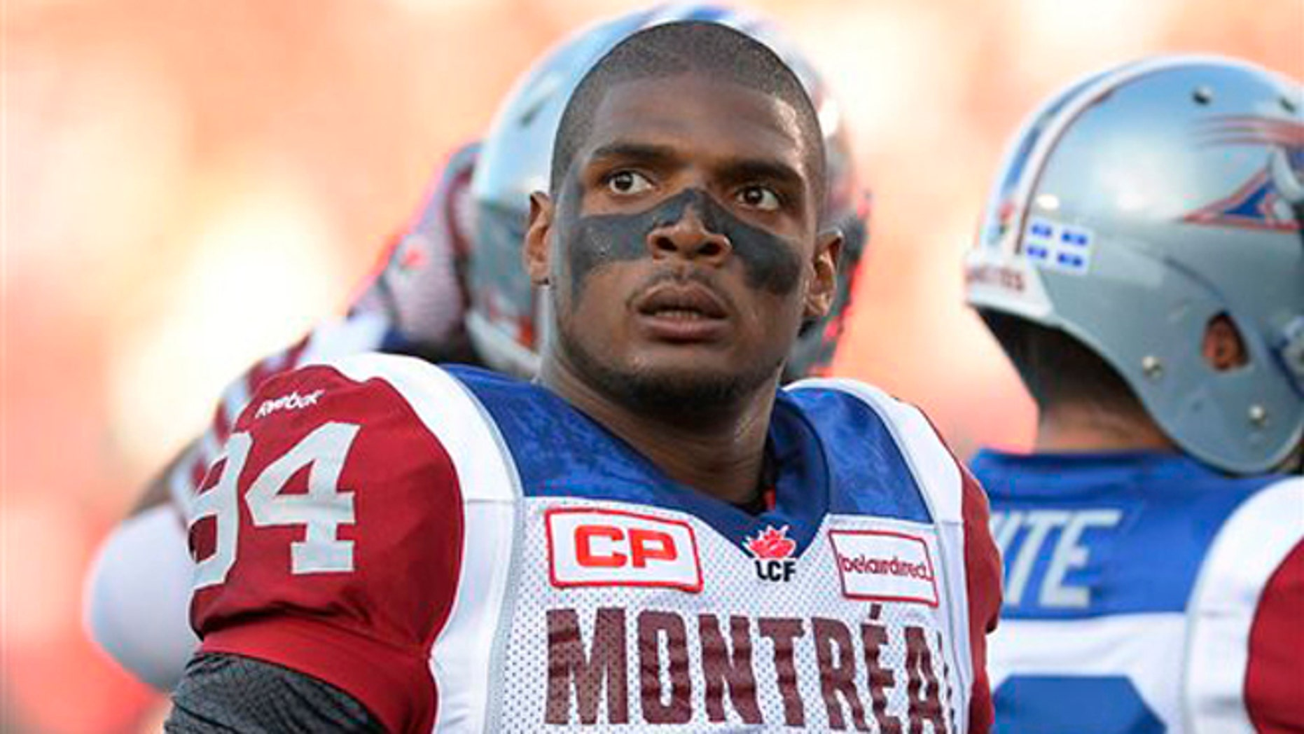Aug. 7, 2014: In this file photo, Montreal Alouettes' Michael Sam and teammates warm up for a Canadian Football League game against the Ottawa Redblacks in Ottawa, Ontario.
