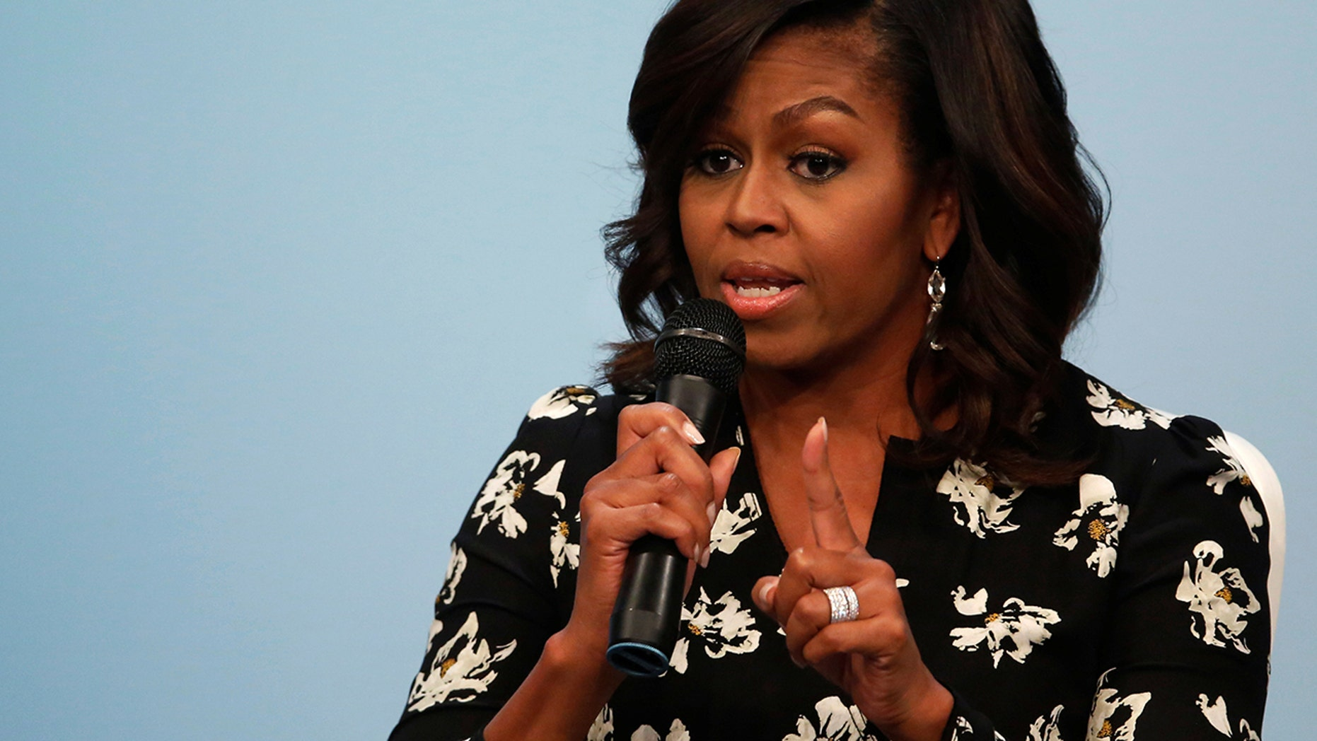 """Former first lady Michelle Obama said, """"Any woman who voted against Hillary Clinton voted against their own voice."""""""
