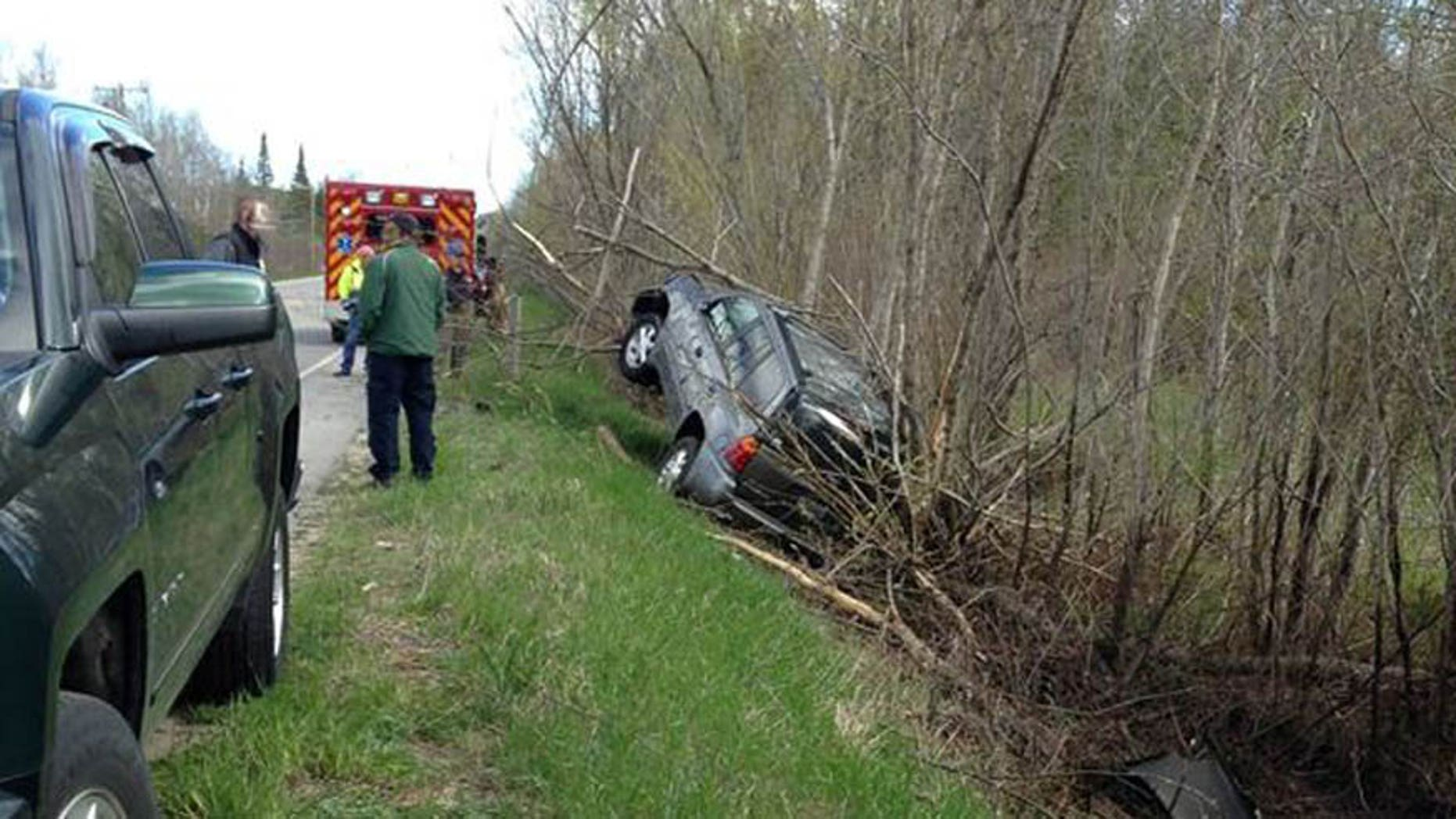 A driver claims he was distracted by a spider before he totaled his car in northern Michigan