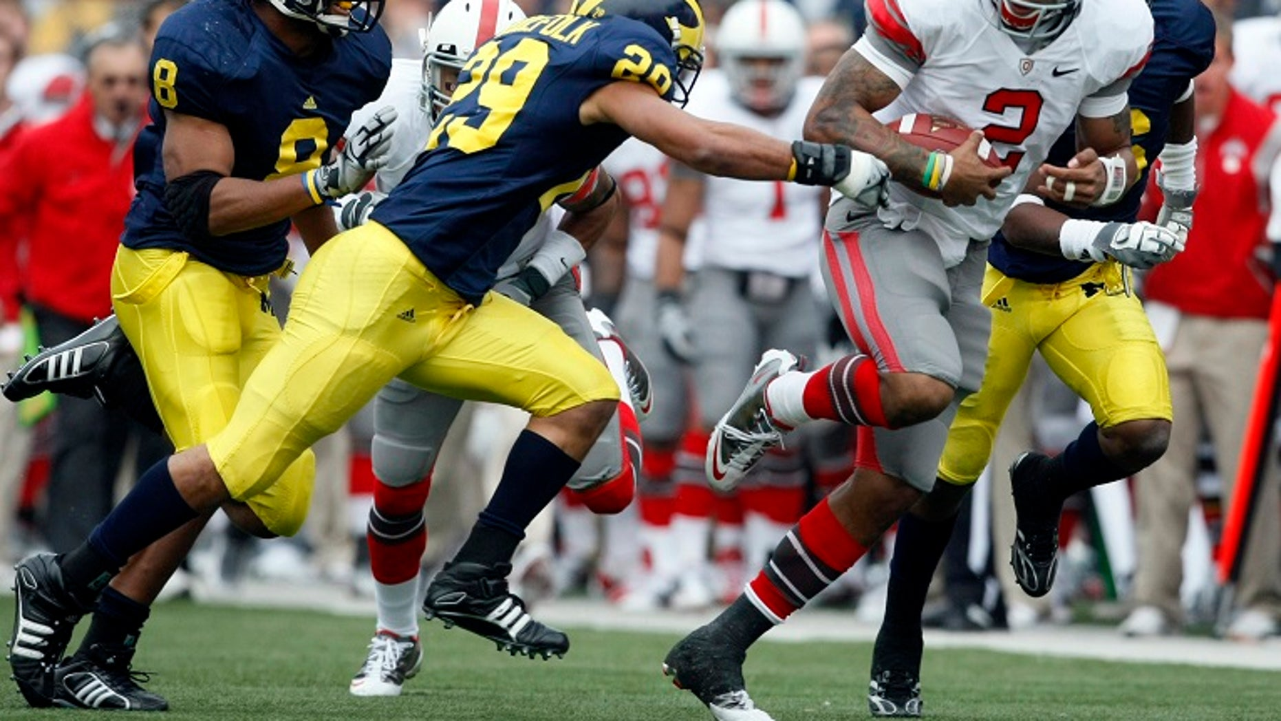 An Ohio man who was severely injured in a car accident in March in Europe is making progress after he was he answered no to liking University of Michigan football team, the Wolverines.