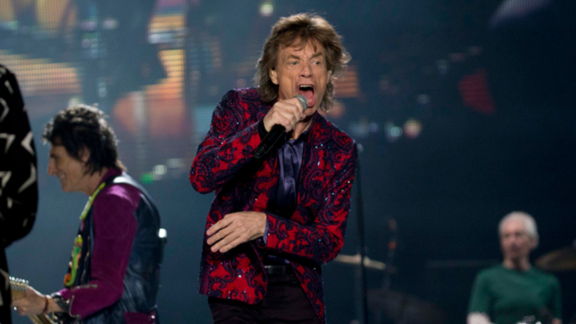 The Rolling Stones' Mick Jagger performs during the band's Ole Tour at Foro Sol in Mexico City, Monday, March 14, 2016. (AP Photo/Eduardo Verdugo)