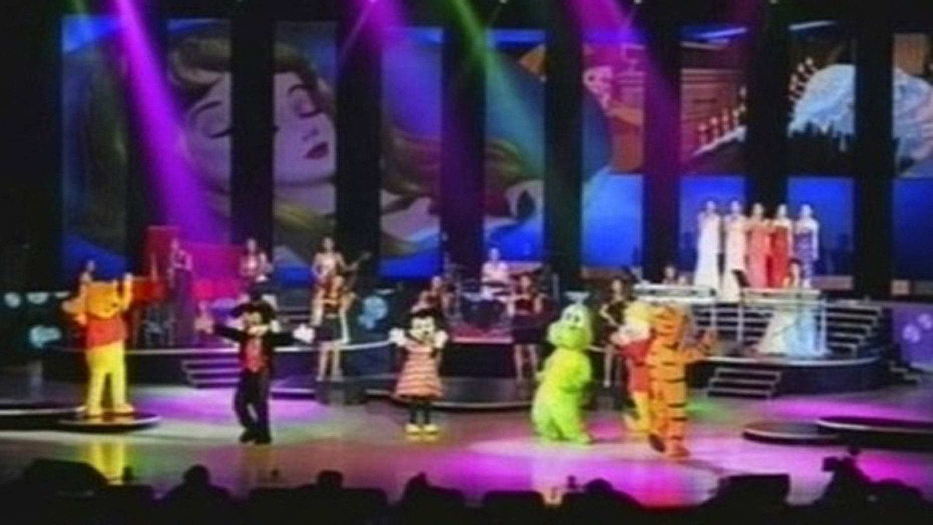 July 6, 2012: In this image made off North Korea's KRT video footage, North Korea's new Moranbong band and performers dressed as America's cartoon characters perform in Pyongyang, North Korea.