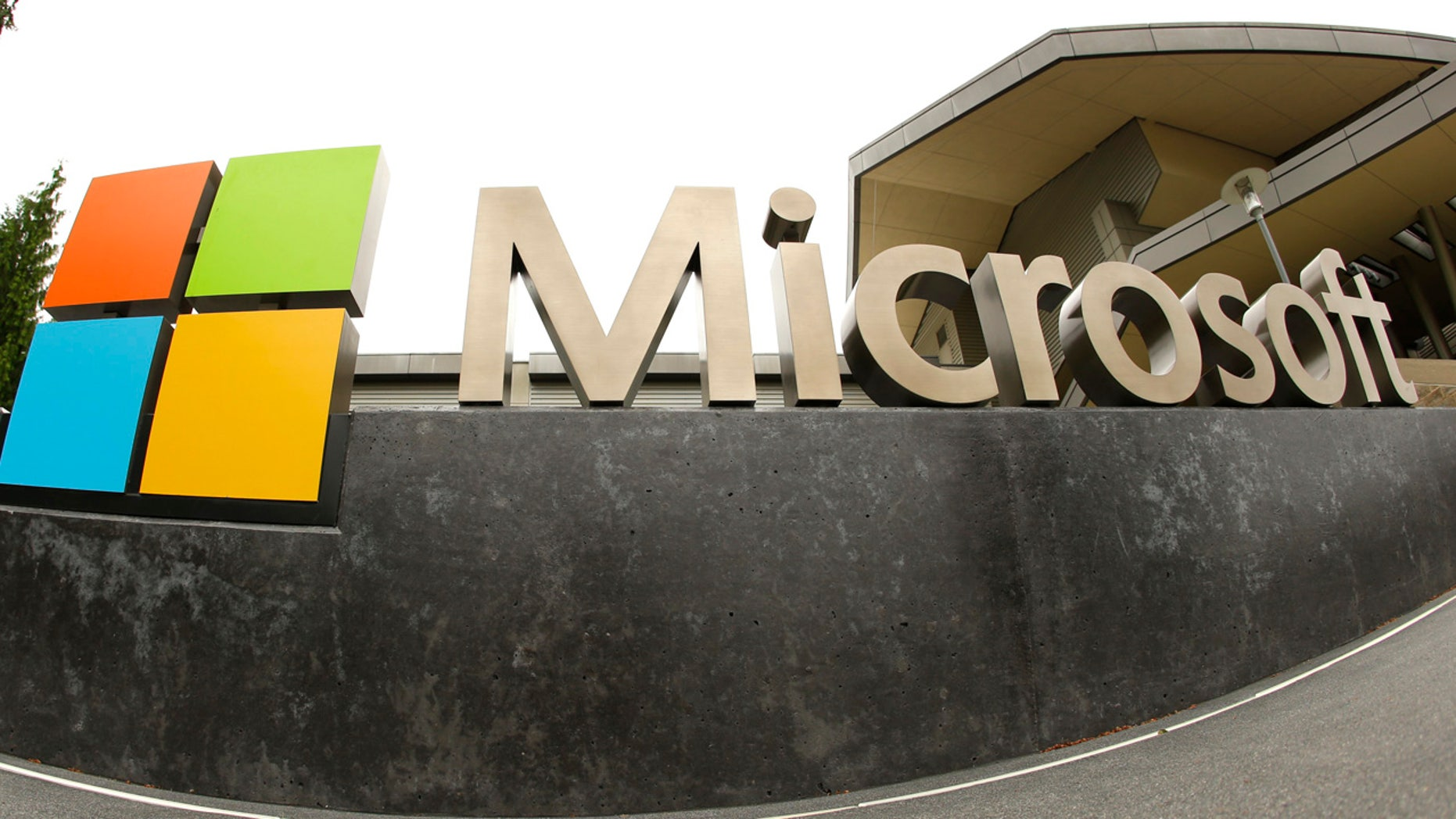 This July 3, 2014, file photo, shows the Microsoft Corp. logo outside the Microsoft Visitor Center in Redmond, Wash. (AP PhotoTed S. Warren)