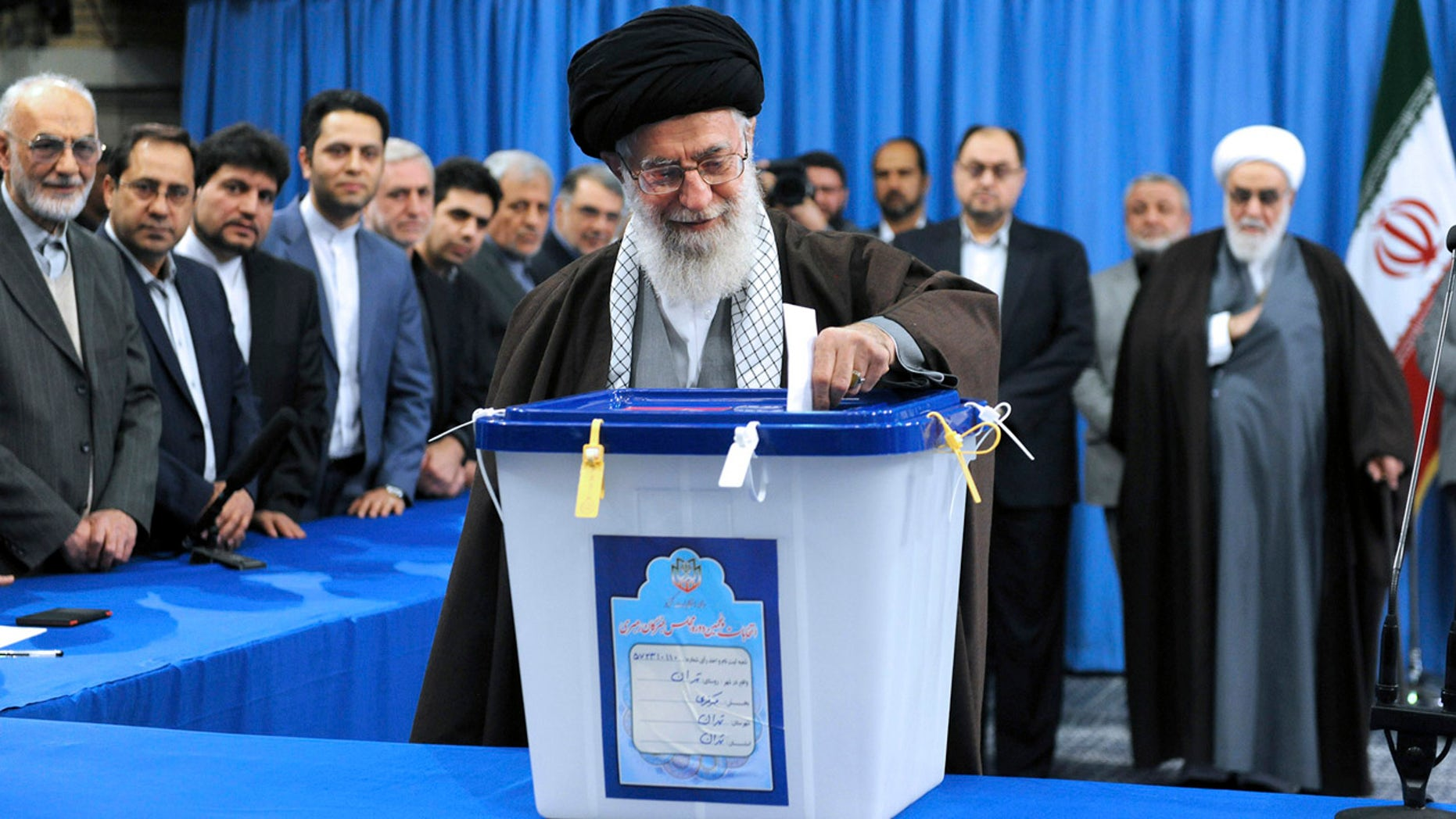 FILE -- Feb. 26, 2016: In this photo released by official website of the office of the Iranian supreme leader, Supreme Leader Ayatollah Ali Khamenei casts his ballot during parliamentary and Experts Assembly elections in Tehran, Iran. (Office of the Iranian Supreme Leader via AP)