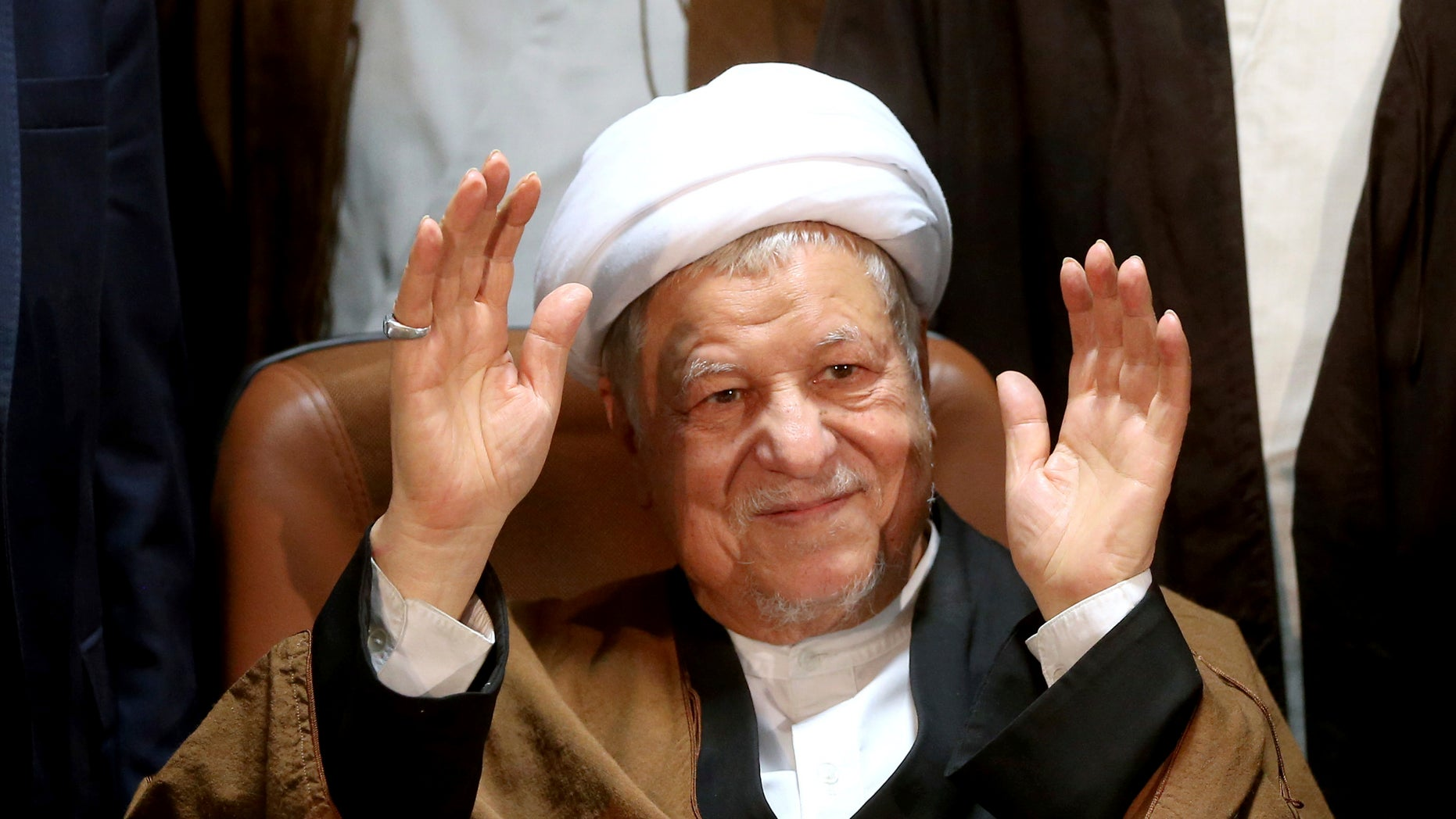 FILE -- Former Iranian President Akbar Hashemi Rafsanjani waves to journalists as he registers his candidacy for the elections of the Experts Assembly, in Tehran, Iran.