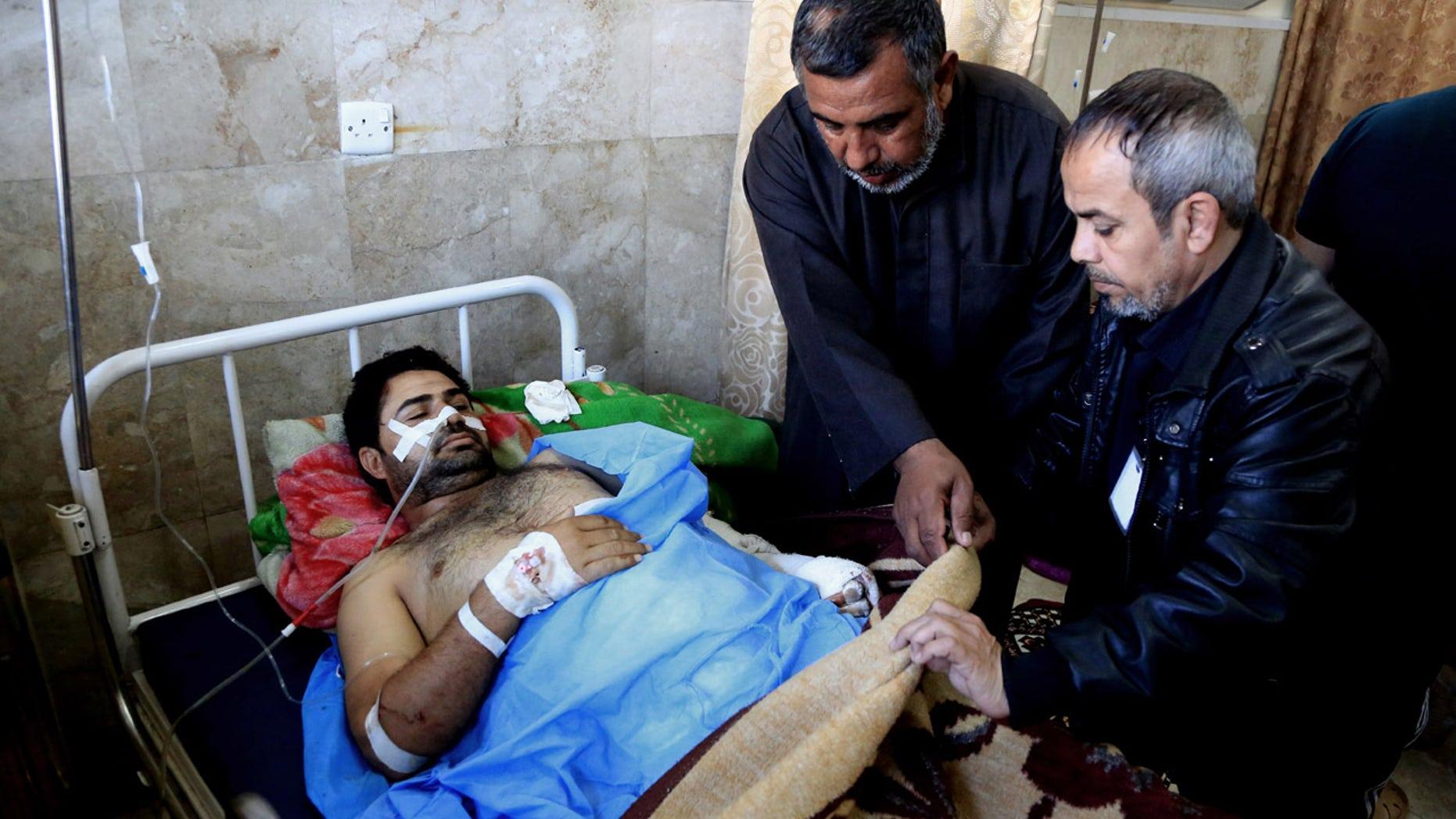 Feb. 29, 2016: An injured victim of bombing attacks receives treatment at the Imam Ali Hospital in Sadr City, Baghdad, Iraq. (AP Photo/Karim Kadim)