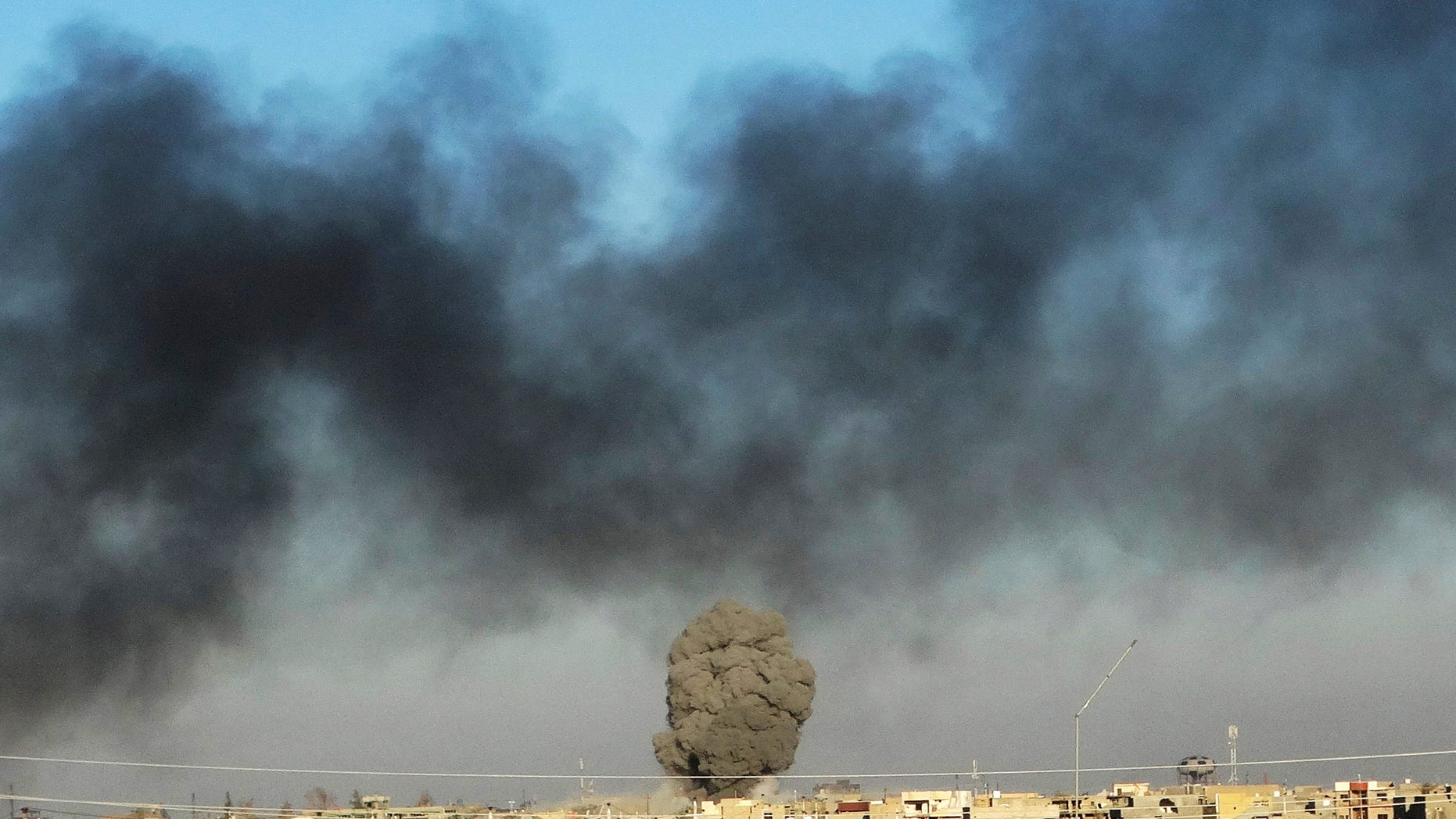 FILE: Dec. 25, 2015: Smoke from Islamic State positions following a U.S.-led coalition airstrike as Iraqi Security forces advance their position in downtown Ramadi, 70 miles west of Baghdad, Iraq. (AP)