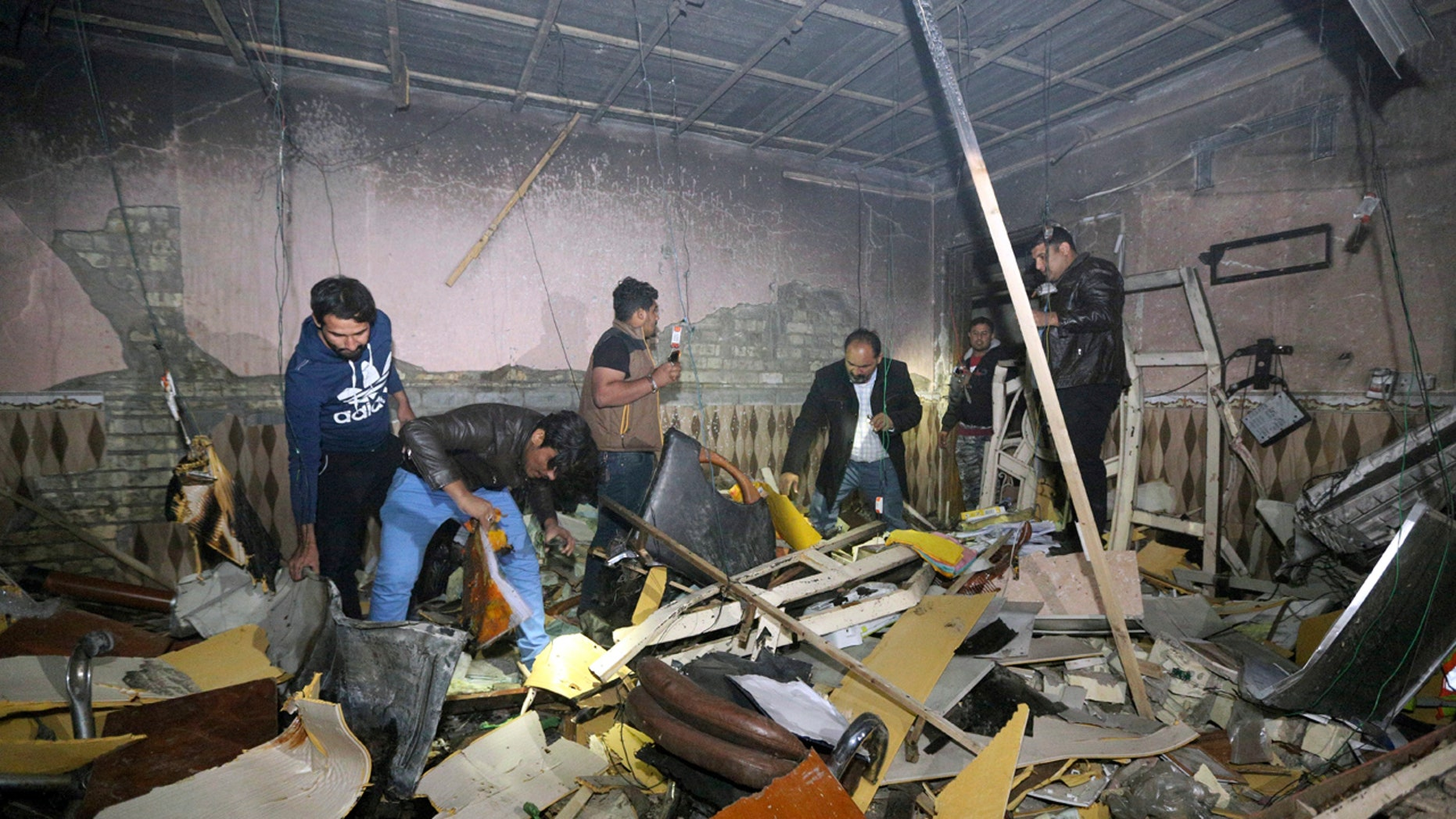 Civilians search for survivors in the rubble at the scene of a car bomb attack near the city of Hilla about 95 kilometers (60 miles) south of Baghdad, Iraq, Thursday, Nov. 24, 2016.