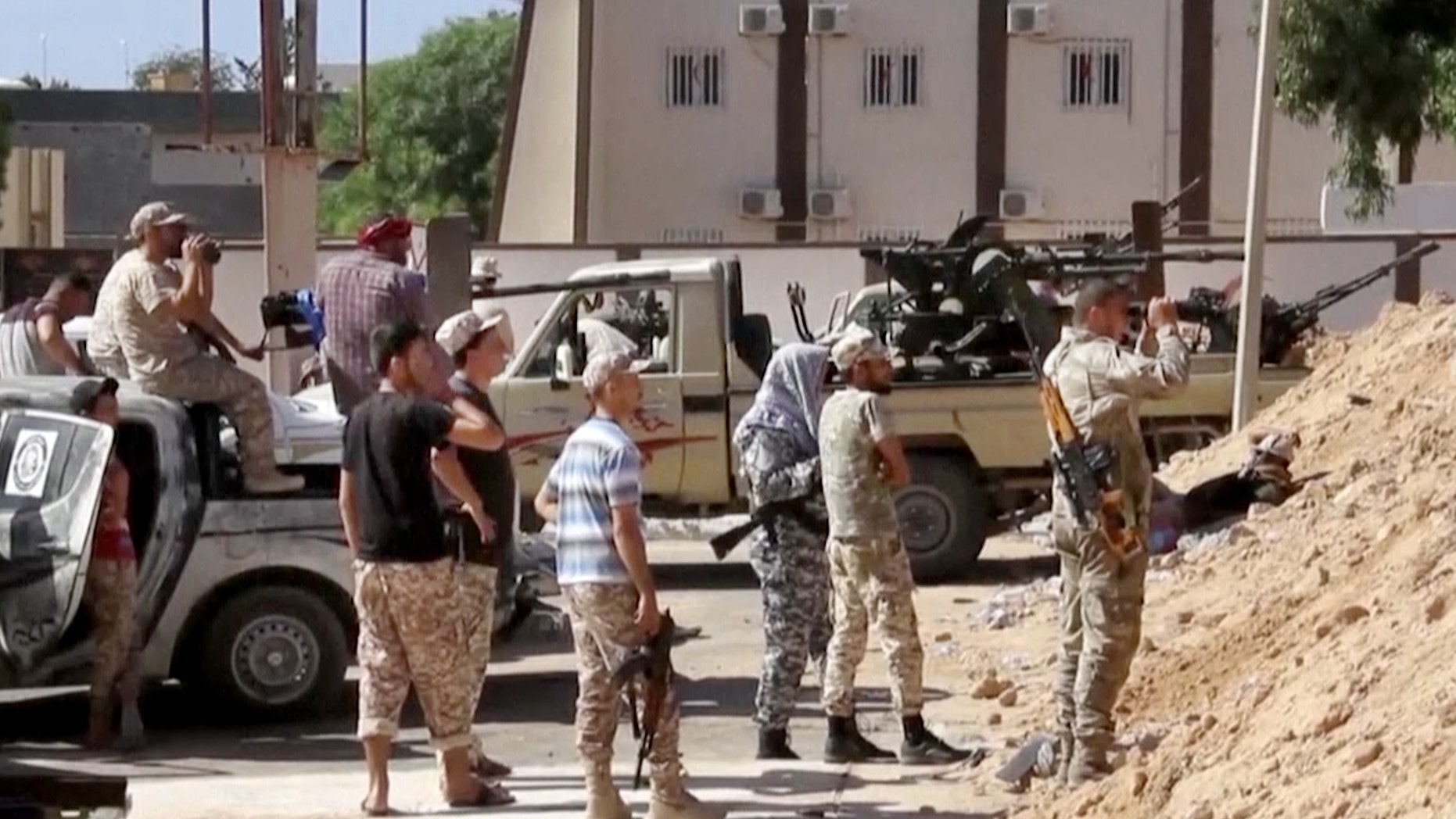 FILE -- June 14, 2016: This image made from Associated Press video shows Armed Misrata fighters loyal to the unity government on the main street of Sirte. A Libyan hospital spokesman says many pro-government fighters have been killed and tens wounded in latest fighting for the Islamic State group's bastion of Sirte. Libyan forces loyal to the unity government have been waging an offensive since last month to dislodge the militants from the coastal city.