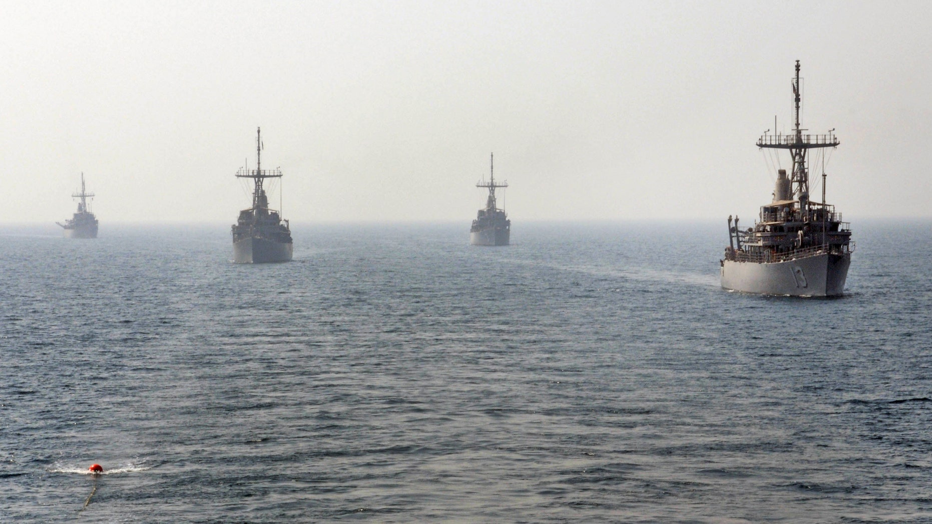 Aug. 29, 2012: This handout photo released by the U.S. Navy, 5th Fleet, shows USS Navy mine counter measure ships, from right to left, USS Dextrous , USS Sentry, USS Devastator and USS Pioneer get in line to conduct an astern replenishment-at-sea.