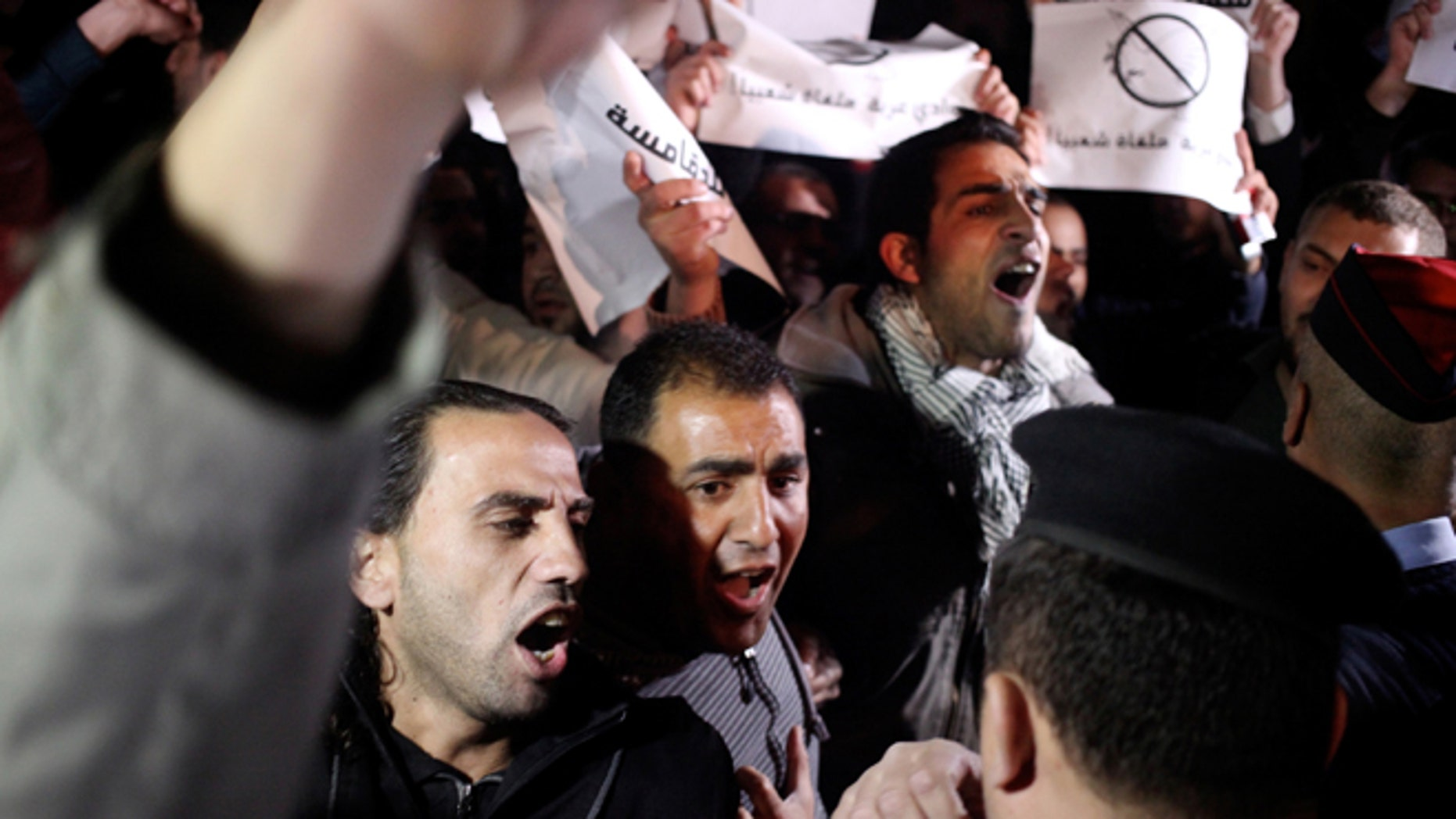 Mar. 10, 2014: Jordanian protesters shout slogans across the street from the Israeli embassy and demand the deportation of the Israeli ambassador after the killing of Jordanian judge Raed Zueter, 38, at Allenby crossing between Jordan and the West Bank, in Amman, Jordan.