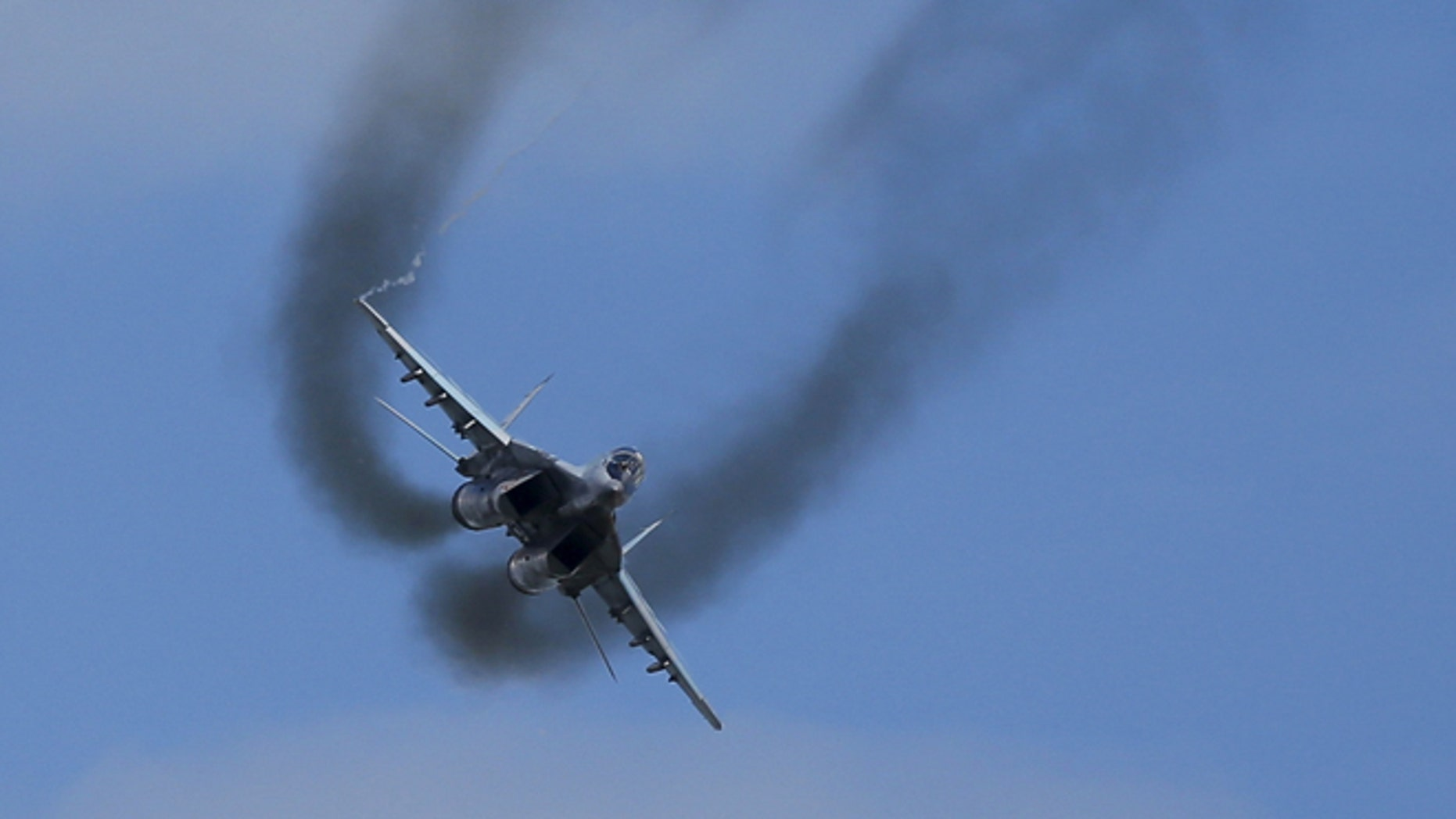 """A MIG-29 fighter performs during the """"Aviadarts"""" military aviation competition at the Dubrovichi range near Ryazan, Russia, August 2, 2015."""